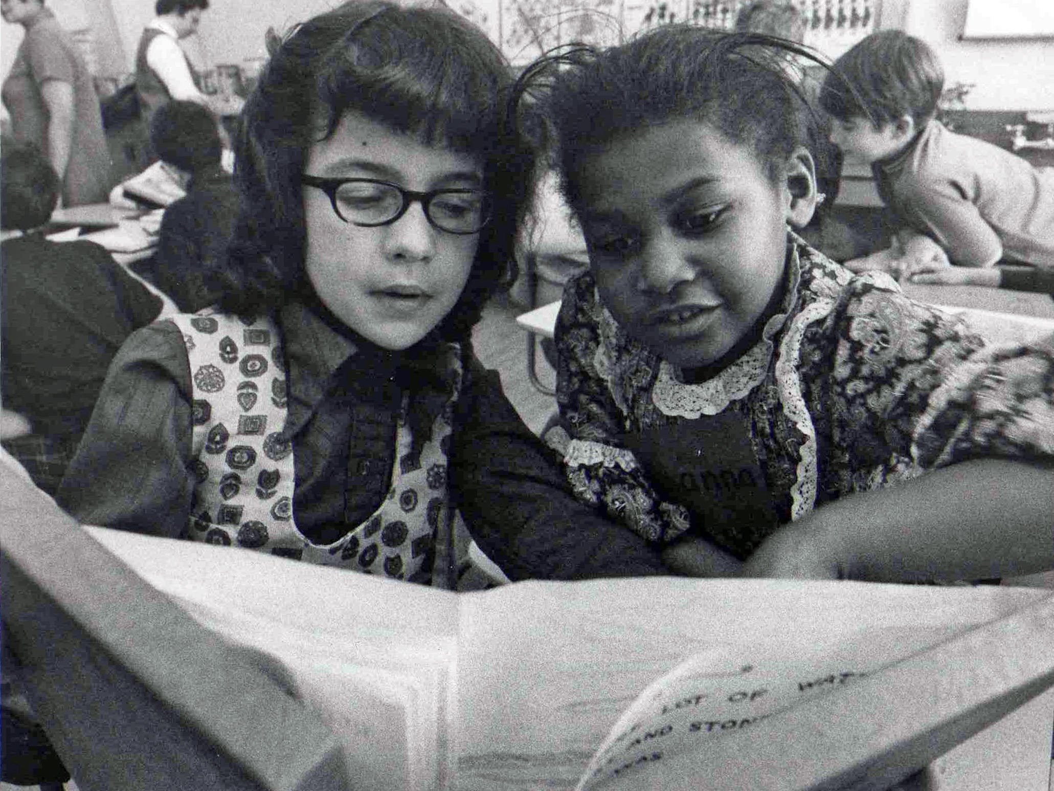 Sharon Johnston, left, and Joanna Gibens, sixth-grade classmates at Windsor Elementary in Des Moines, check out some information in this photo from 1969.