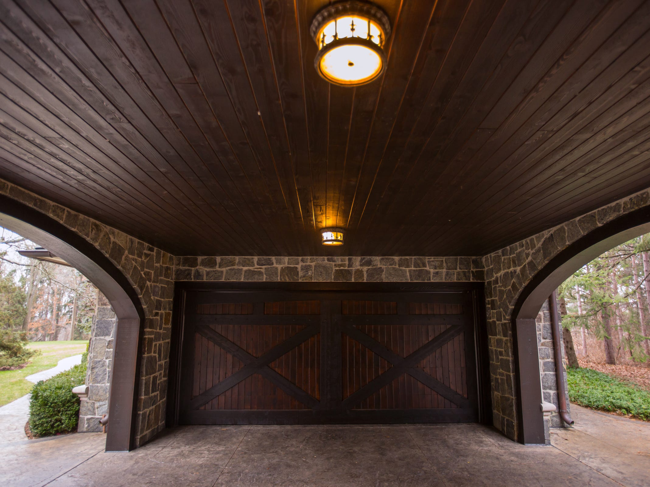 An arched cover between two garages attached to the 5,000 sq. ft. 3-bedroom home in Washington Township envisioned after the Biltmore Estate designed by Alex Bogarts and built by an award winning builder as his own personal residence. The home sets back into the exterior boundary line of Stoney Creek Metro Park.
