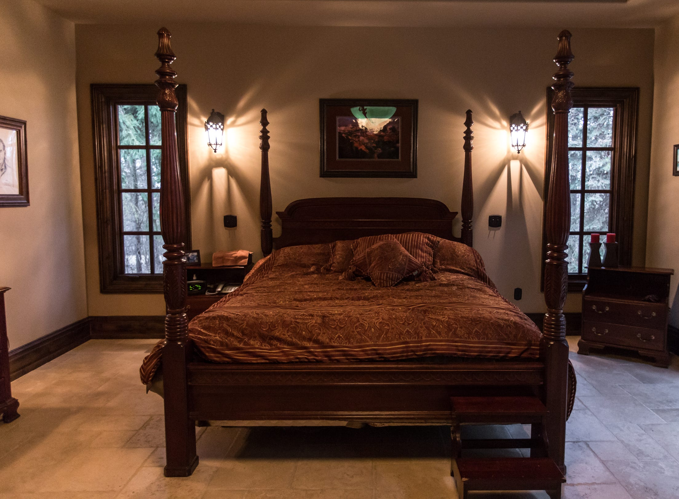 A view of the master bedroom with Amish hand hewn beams and alder wood ceiling is seen in the home envisioned after the Biltmore Estate designed by Alex Bogarts and built by an award winning builder as his own personal residence.