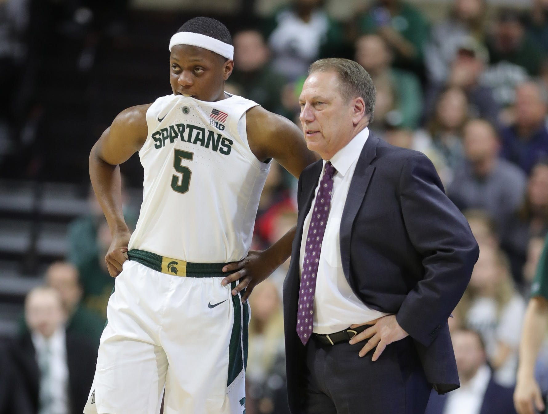 Michigan State head coach Tom Izzo talks with Cassius Winston during first half action against Northwestern  Wednesday, January 2, 2019 at the Breslin Center in East Lansing, Mich.