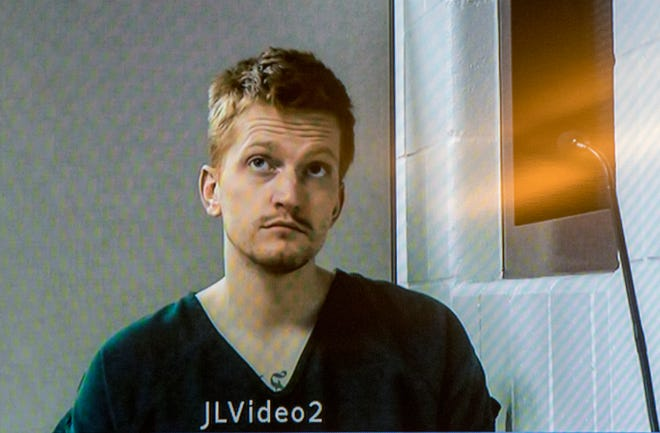 In this Dec. 5, 2018, file photo, Jared Chance appears on a monitor during a video arraignment at the Kent County Courthouse in Grand Rapids, Mich.