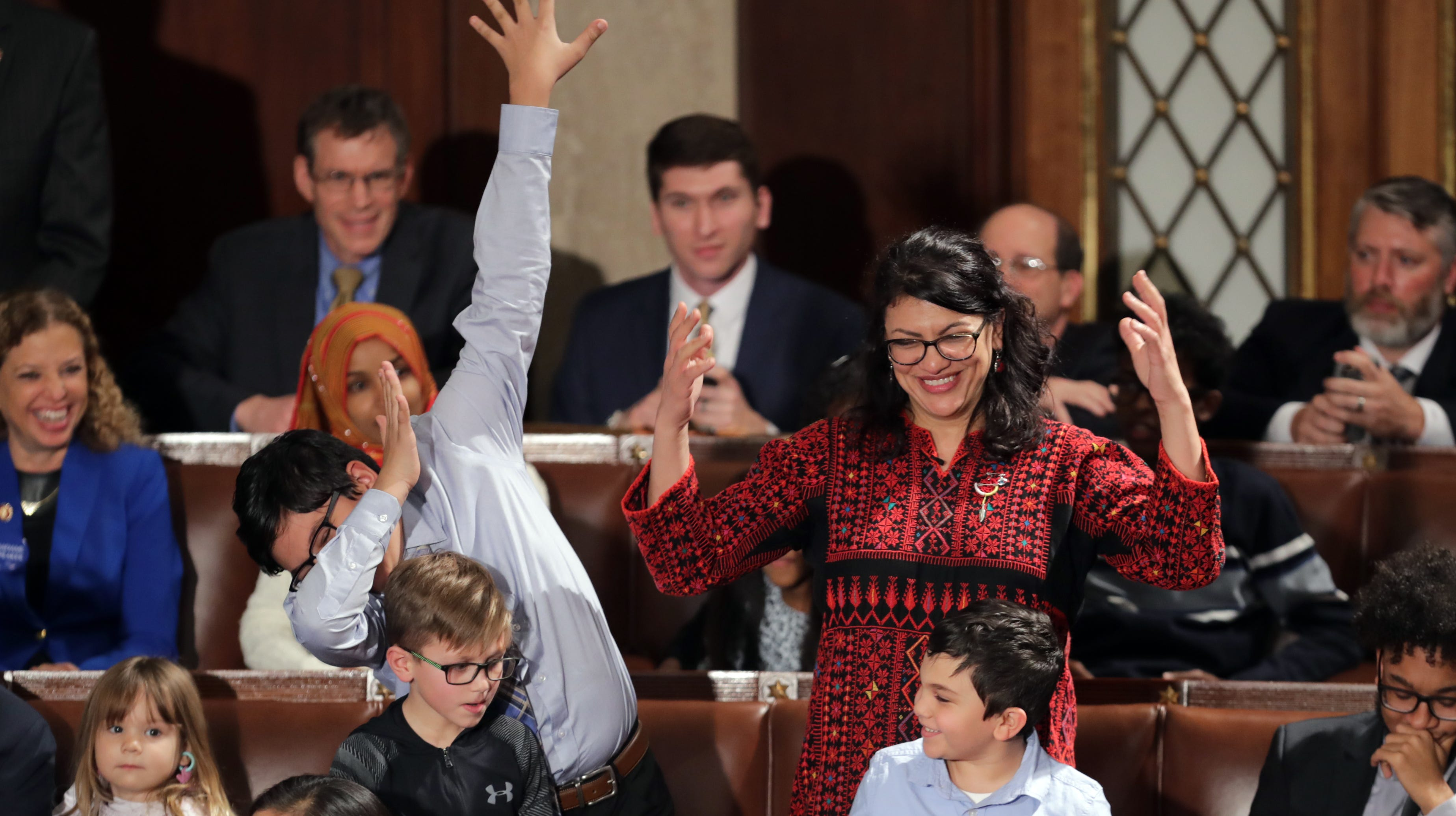Rep.-elect Rashida Tlaib (D-MI) votes for Speaker-designate Rep. Nancy Pelosi (D-CA) along with her kids during the first session of the 116th Congress at the U.S. Capitol Jan. 3, 2019, in Washington, DC.