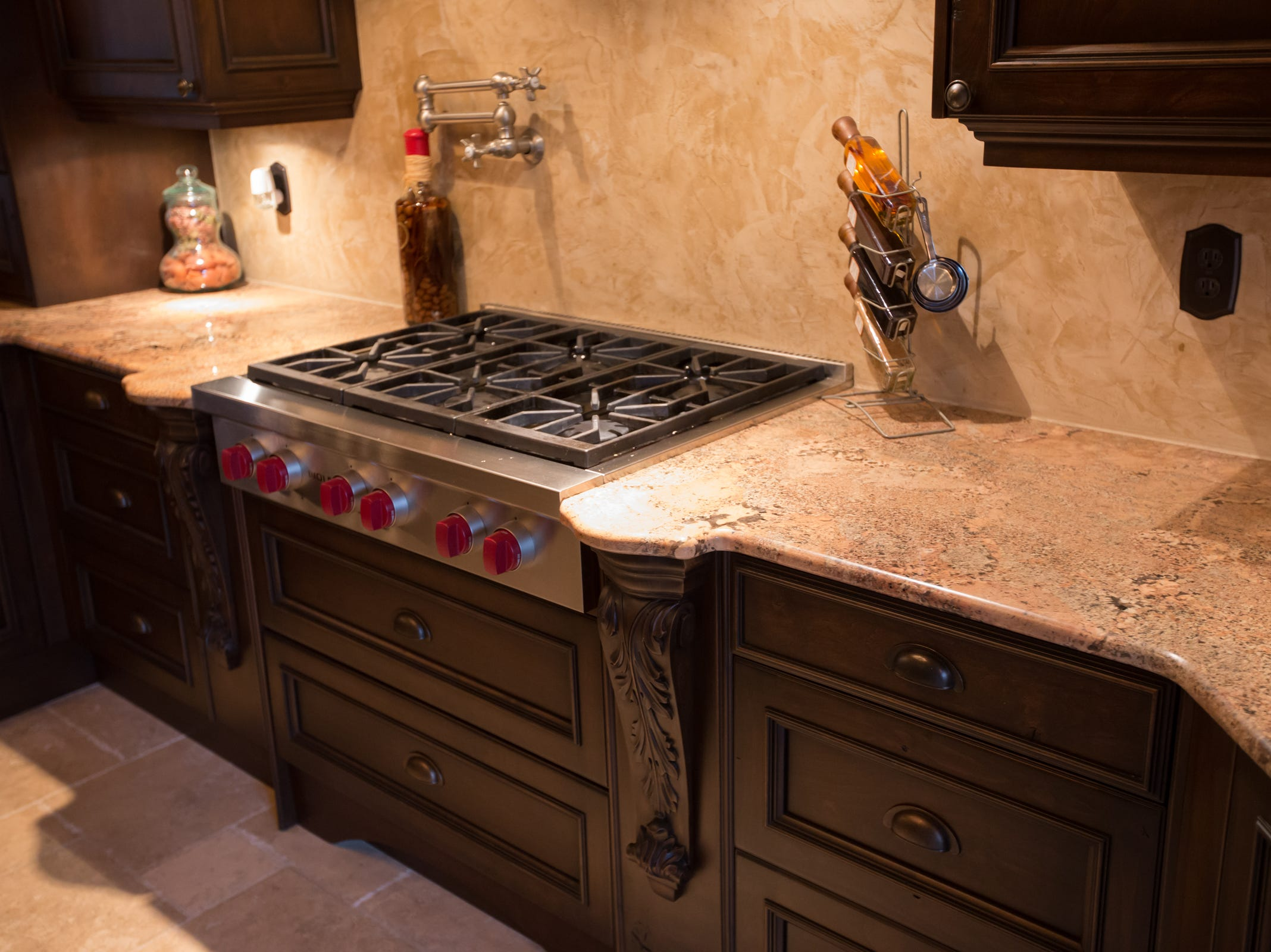 A Wolf stainless still gas cooktop in the kitchen.