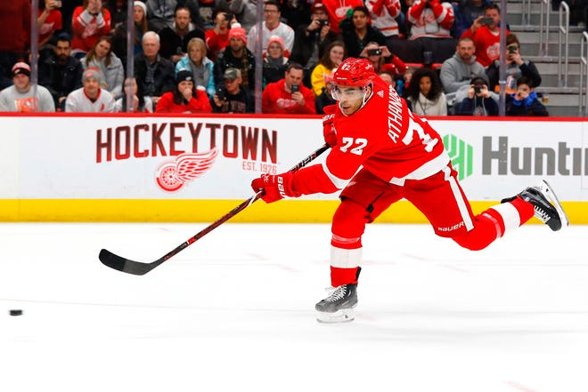 Detroit Red Wings center Andreas Athanasiou (72) shoots the puck to score a goal in the second period against the Calgary Flames at Little Caesars Arena.