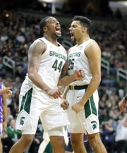Michigan State forwards Nick Ward (44) and Kenny Goins (25) celebrate after a Ward basket against Northwestern during first half action Wednesday, January 2, 2019 at the Breslin Center in East Lansing, Mich.