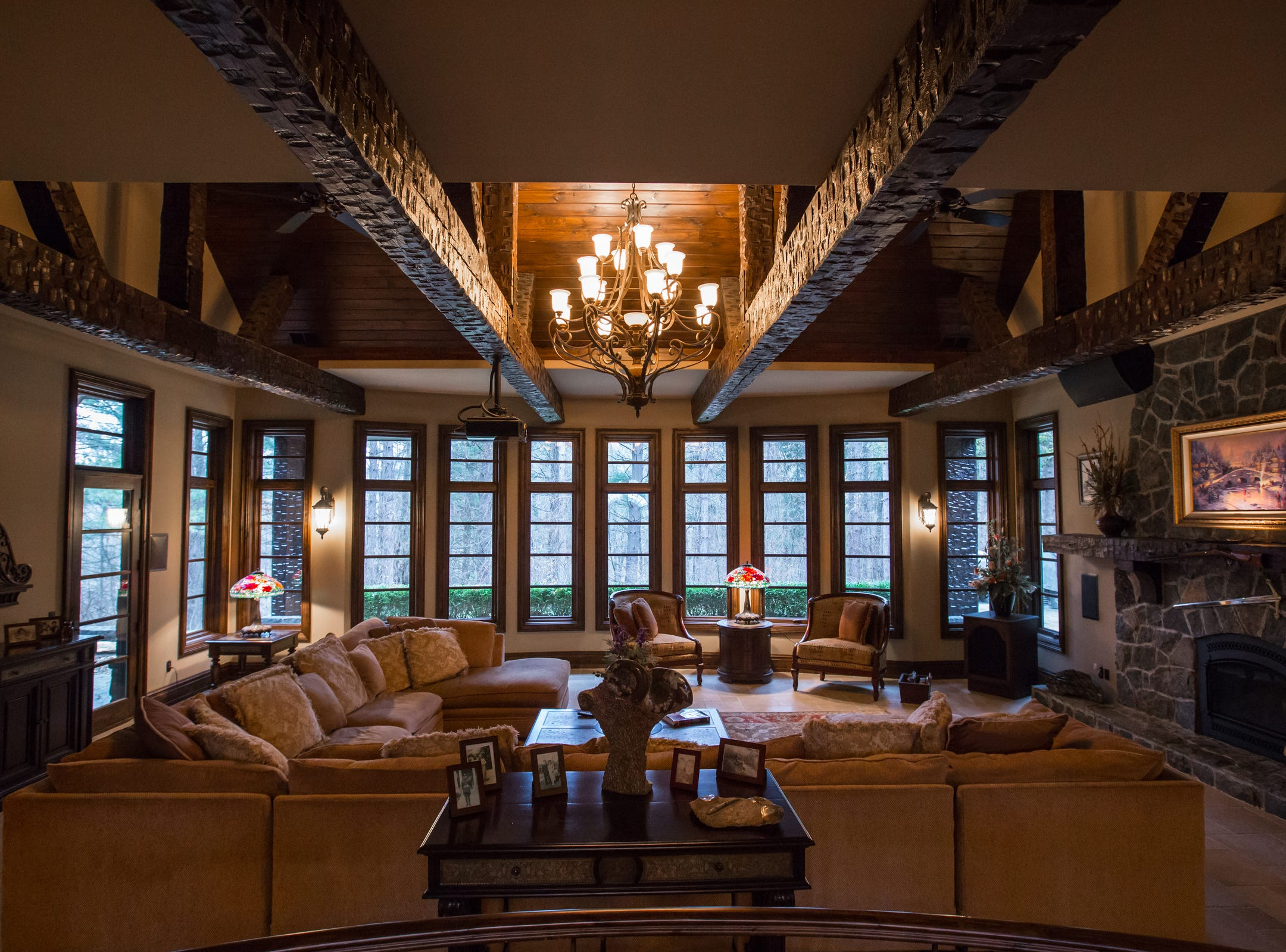 Amish hand hewn beams are leading lines into the great room of the home envisioned after the Biltmore Estate designed by Alex Bogarts and built by an award winning builder as his own personal residence.