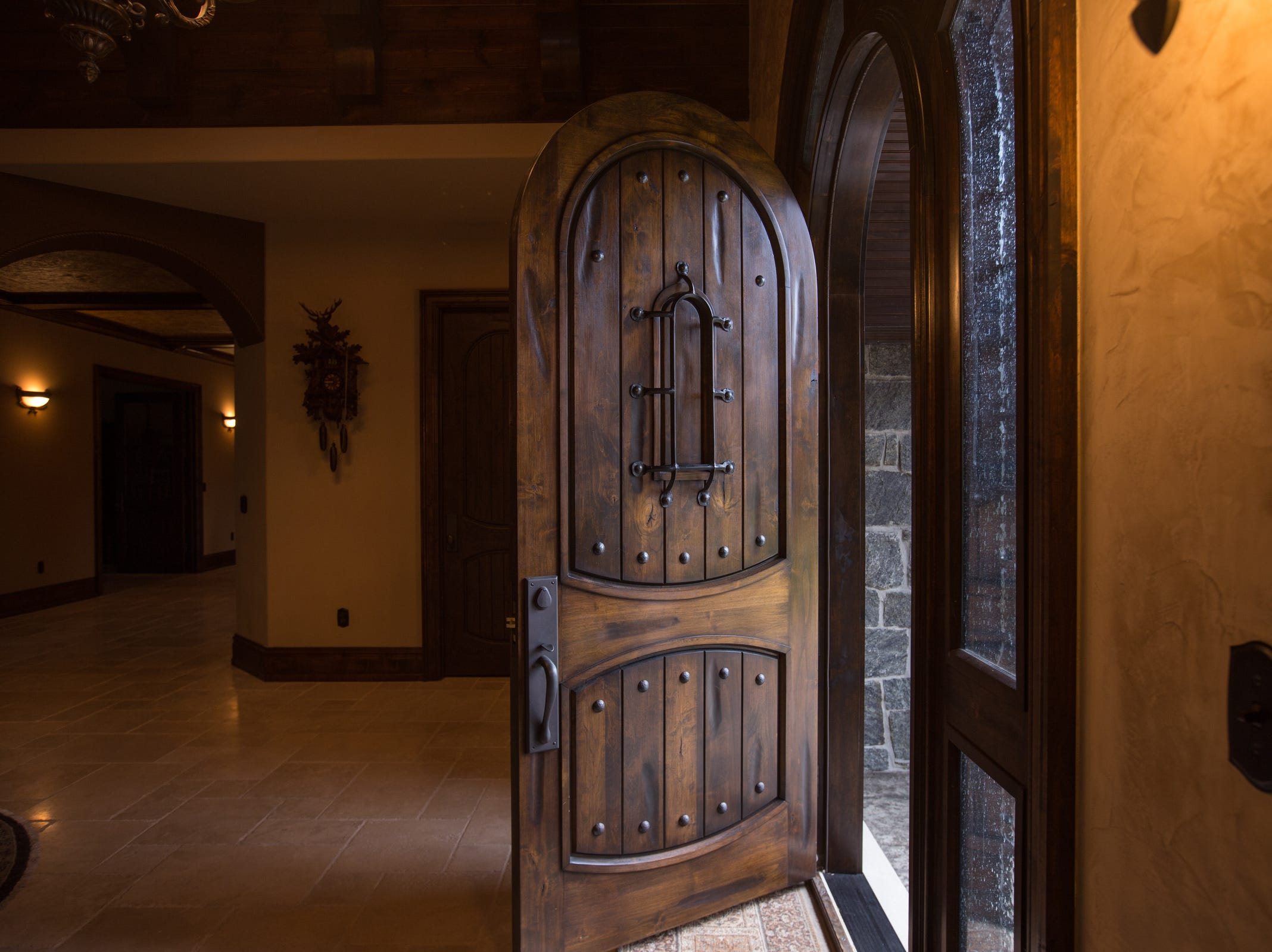 The large wooden entryway door is opened into the foyer.