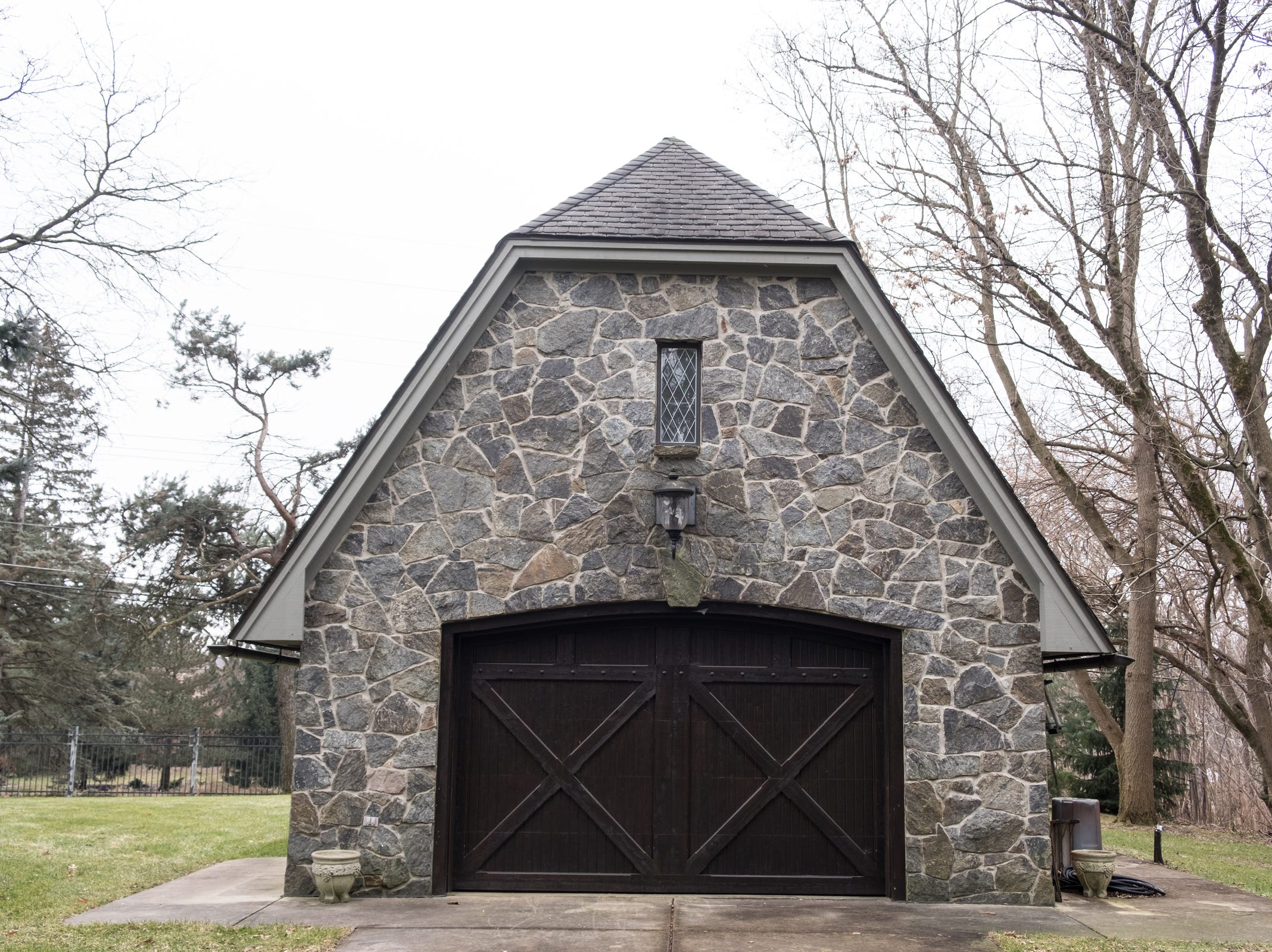 Blue mountain granite covers the front of a detached garage of the 5,000 sq. ft. 3-bedroom home in Washington Township.