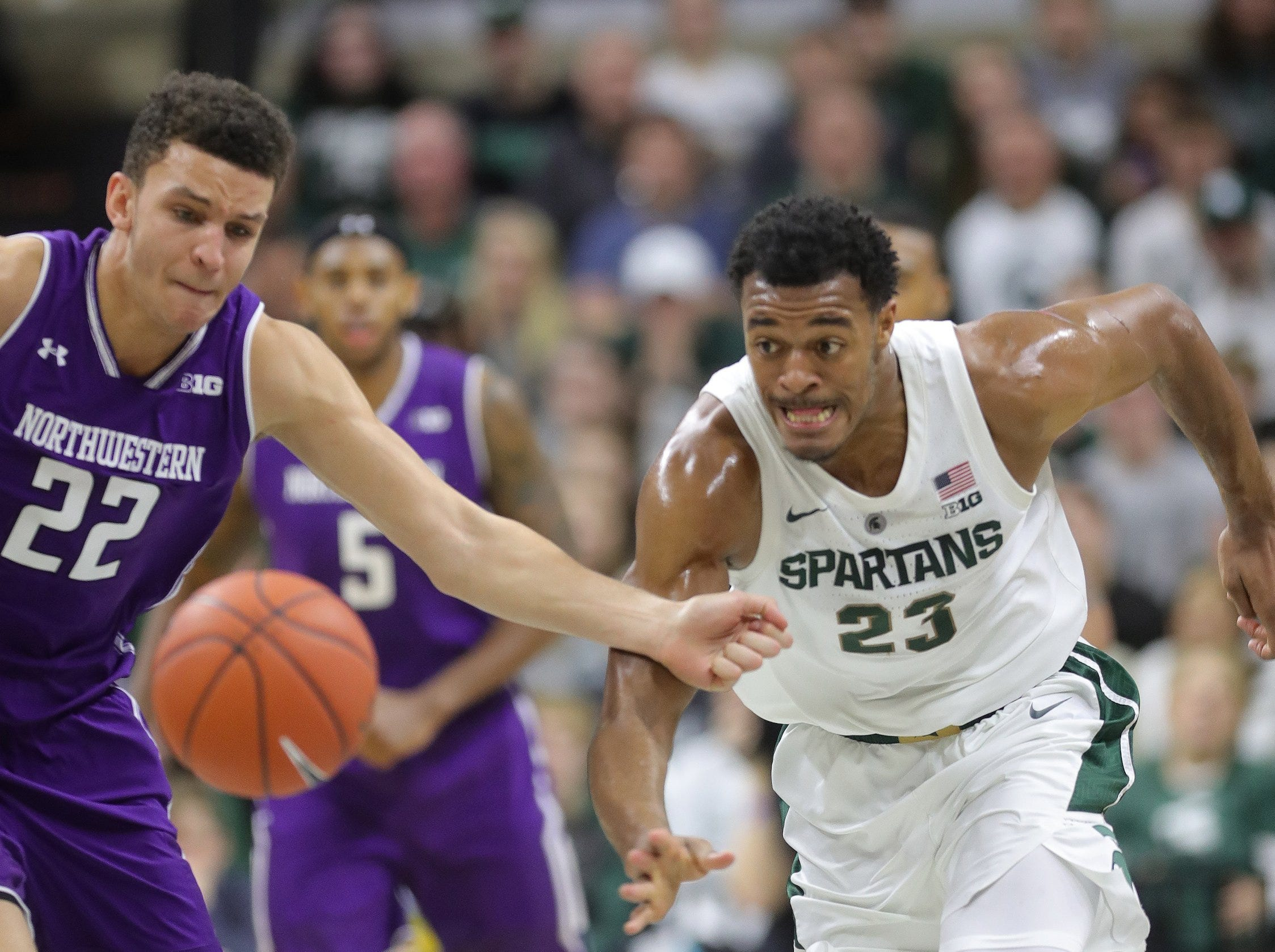 Michigan State forward Xavier Tillman defends against Northwestern forward Pete Nance during first half action Wednesday, January 2, 2019 at the Breslin Center in East Lansing, Mich.
