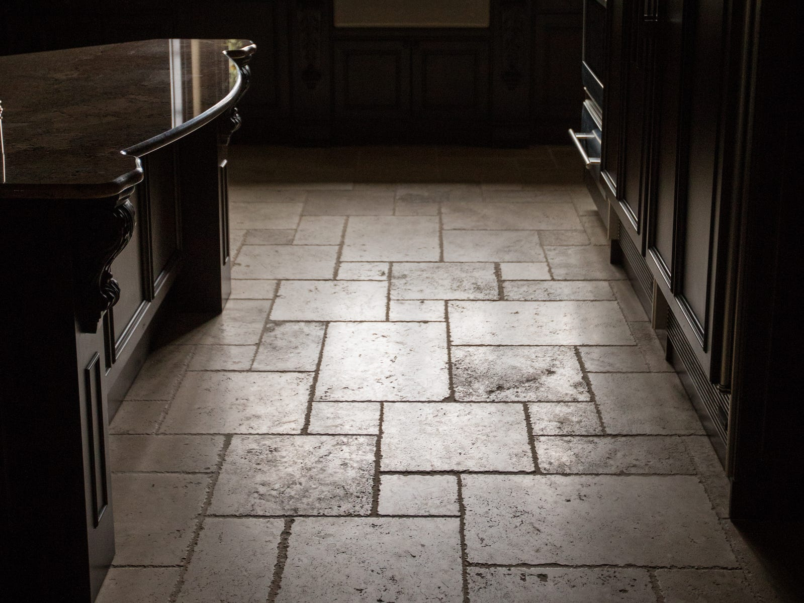 Natural limestone tile imported from Italy is seen in the kitchen.