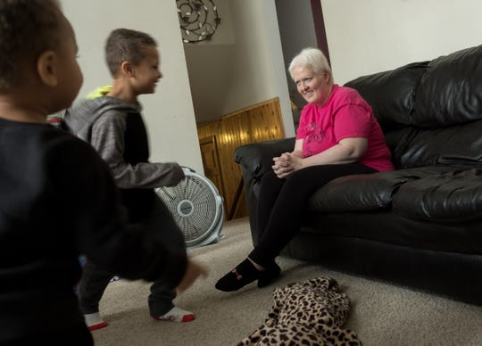 Kim Voelker-Wesley, 41 , Montrose watches her sons Donald Wesley (left), 6 and Cameron Wesley, 3, run around the living room while at home on vacation from school their home in Montrose on Thursday, January 3, 2019. Voelker-Wesley struggles for skin cancer that spreads to her breasts, lungs and lives after being in remission for five years. The disease has robbed her of her livelihood and independence, but not her hopes. She has a New Year's resolution: to live.