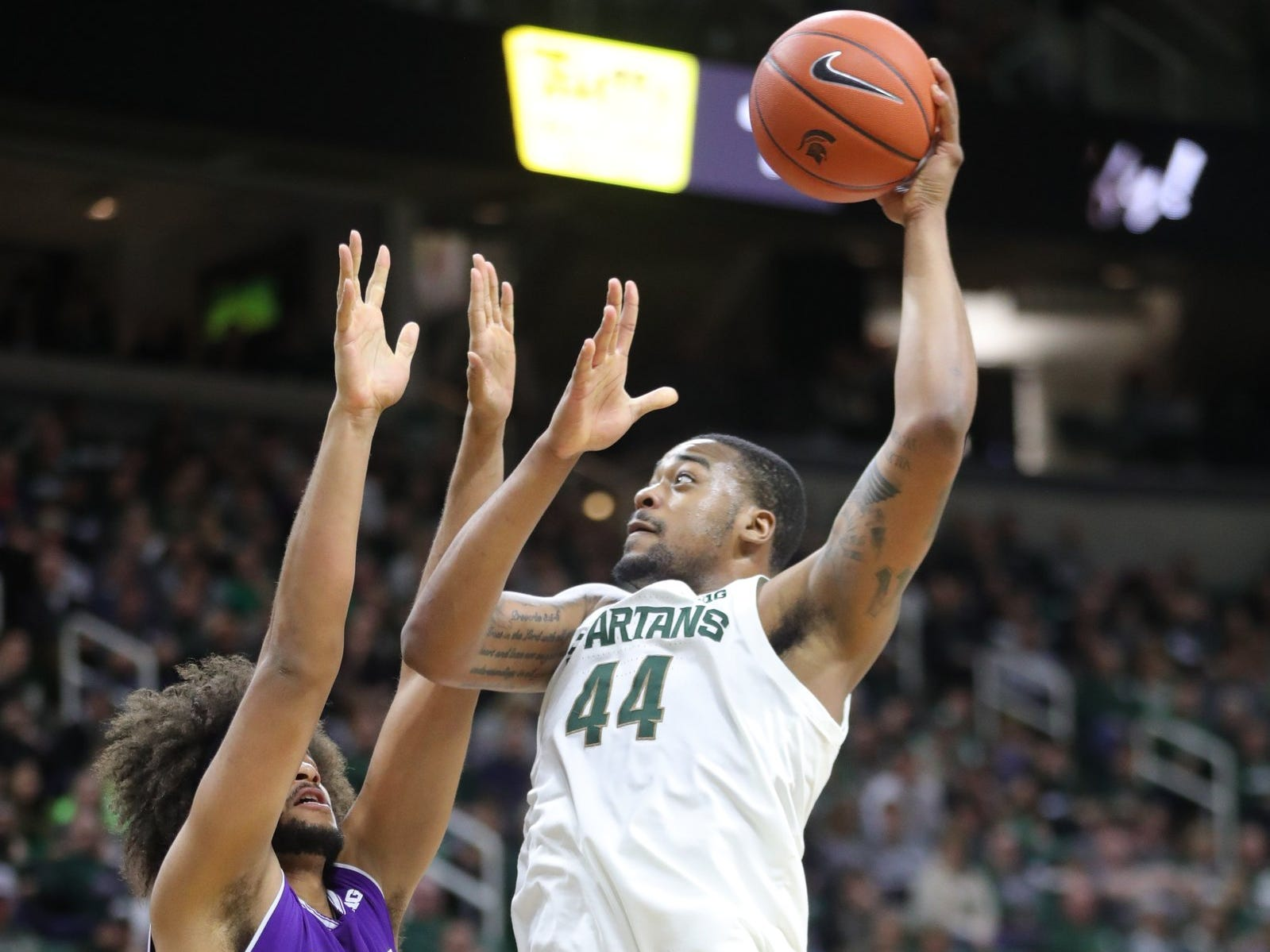 Michigan State forward Nick Ward scores against Northwestern center Barret Benson during the first half Wednesday, Jan. 2, 2019 at the Breslin Center in East Lansing.