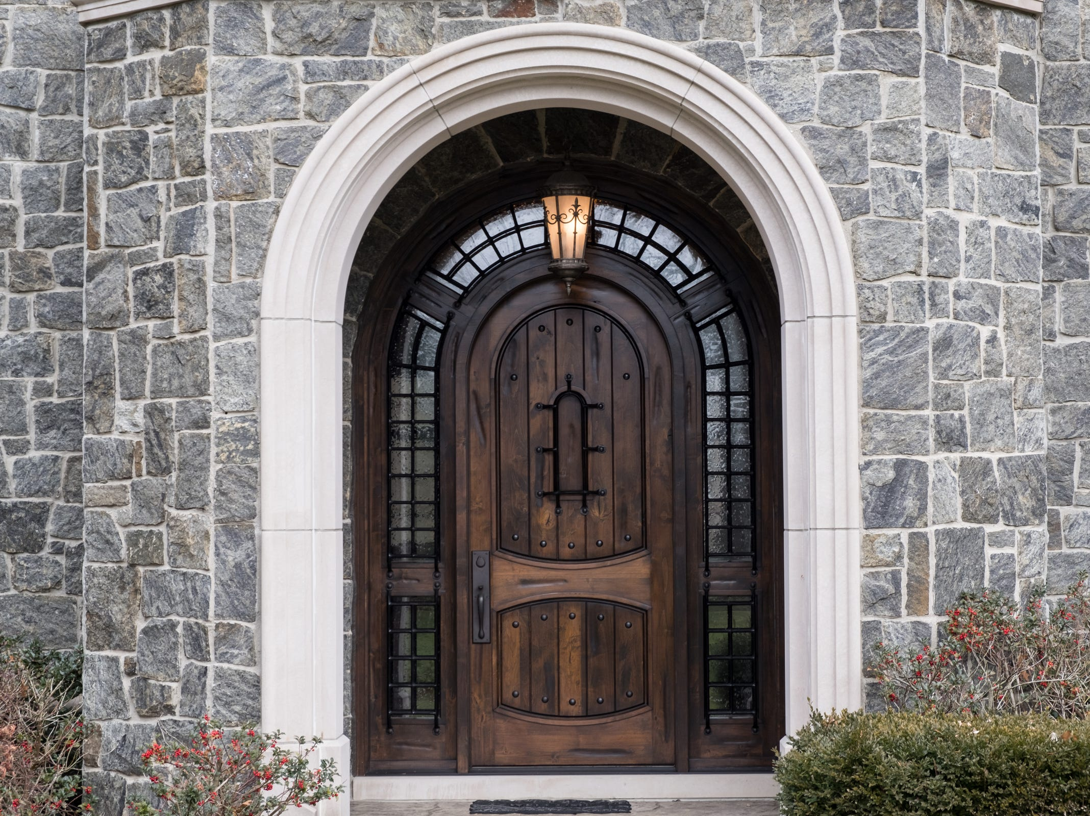A large wooden front door at the entry to the 5,000 sq. ft. 3-bedroom home in Washington Township envisioned after the Biltmore Estate.