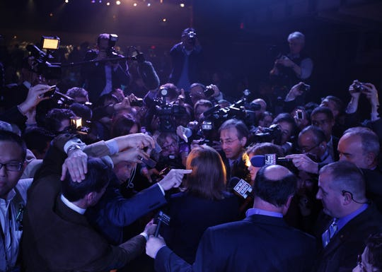 General Motors incoming CEO Mary Barra is surrounded by a mob of media after introducing the all-new 2015 GMC Canyon during an event at the Russell Industrial Center in Detroit on Sunday Jan. 12, 2014.