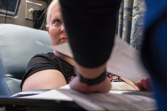 Kim Voelker-Wesley, 41, of Montrose listens to test results before the start of her chemotherapy at the Rose Cancer Center in Royal Oak on Monday, December 31, 2018. Voelker-Wesley is battling skin cancer that spread to her breast, lungs and liver after being in remission for five years. The disease has robbed her of her livelihood and independence, but not her hopes. She has one New Year's Resolution: to live.