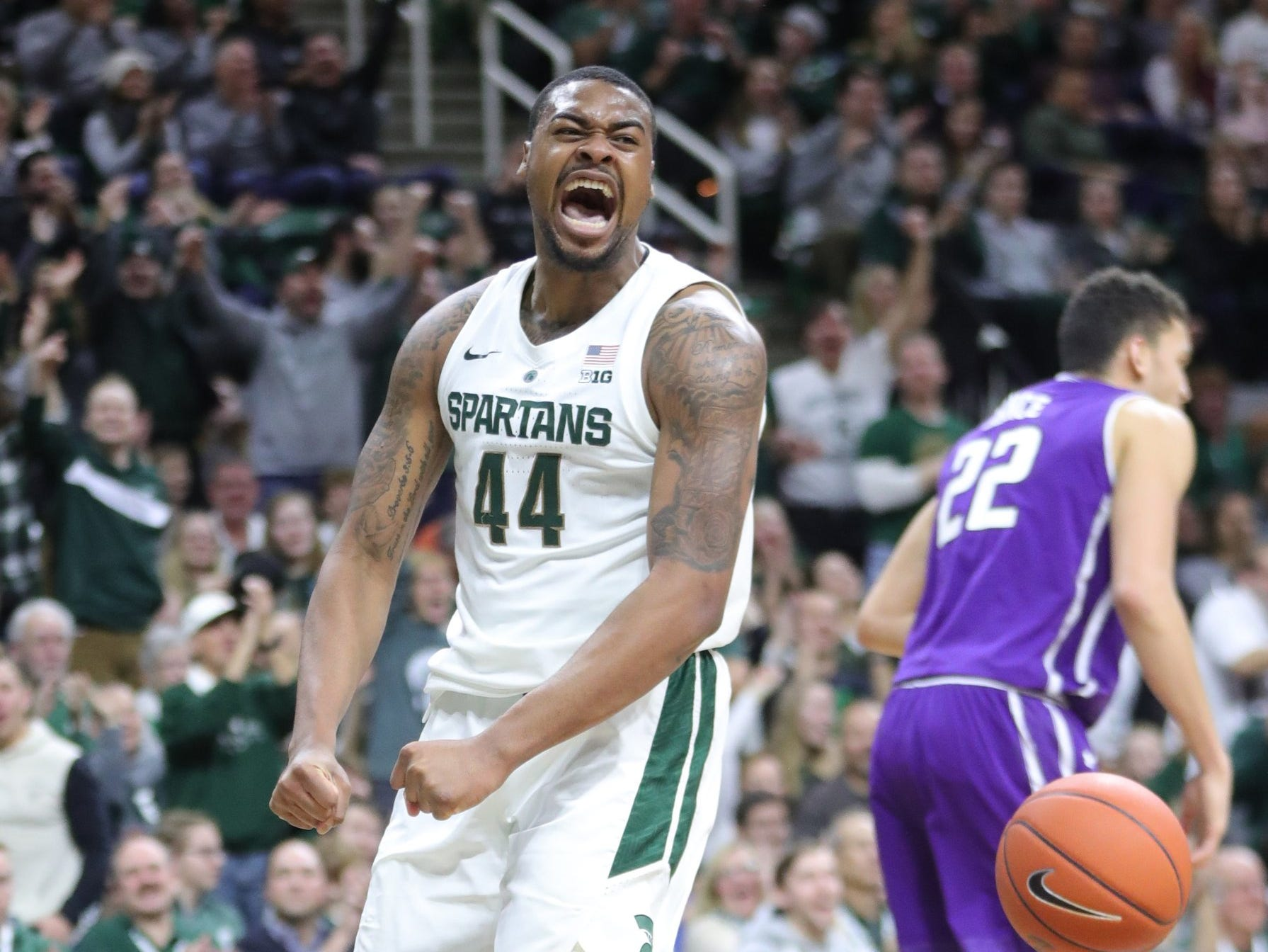 Michigan State forward Nick Ward reacts after a dunk  against Northwestern during first half action Wednesday, January 2, 2019 at the Breslin Center in East Lansing, Mich.