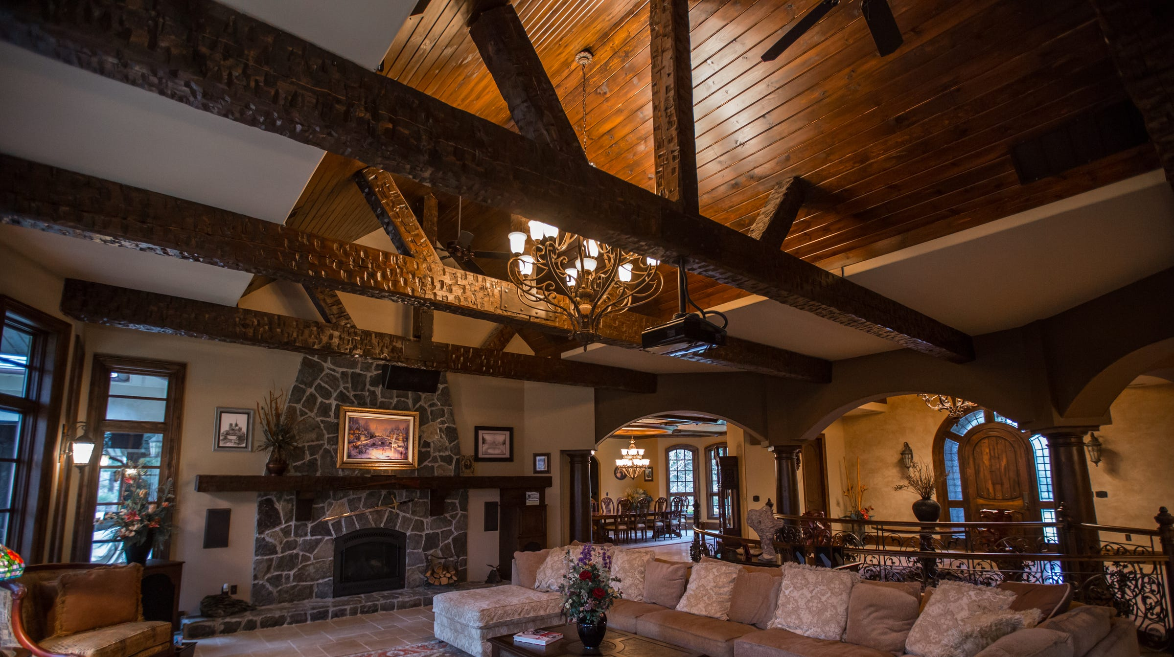 The living room, which the owners call the great room, has a fireplace of blue mountain granite, an alder-lined cathedral ceiling, rough-hewn beams and a view of the foyer. A 10-foot movie screen drops down in front of the fireplace.