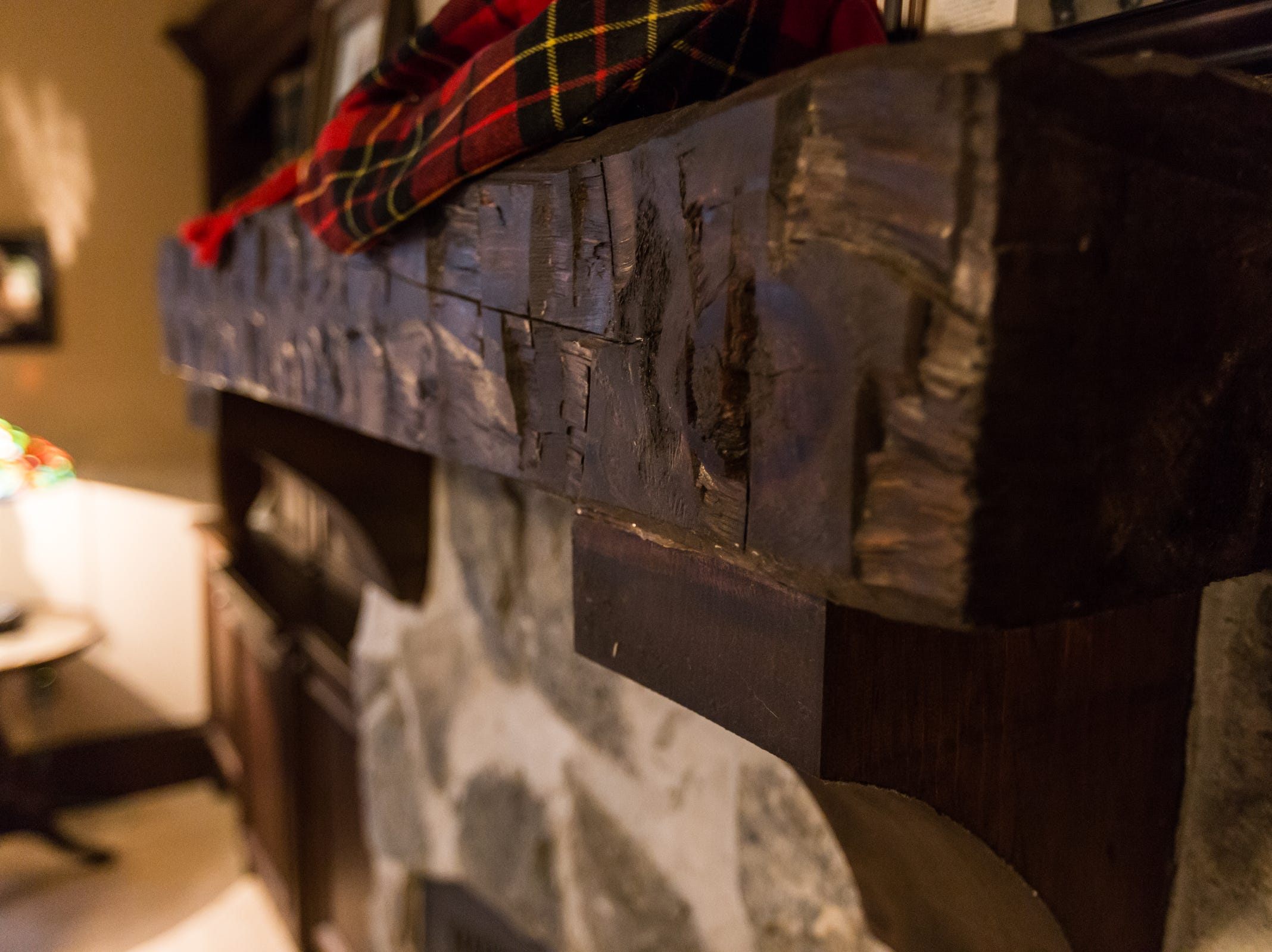 Amish hand hewn wood mantel on the fireplace in the master bedroom.