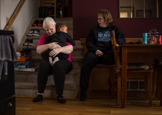 Kim Voelker-Wesley, 41, of Montrose hugs her son Cameron Wesley, 3, as her mother Terrie Gronau of Montrose looks on while sitting in the dining room of her home in Montrose on Thursday, January 3, 2019.