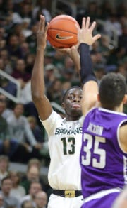 Gabe Brown shoots against Northwestern on Jan. 2 at the Breslin Center.