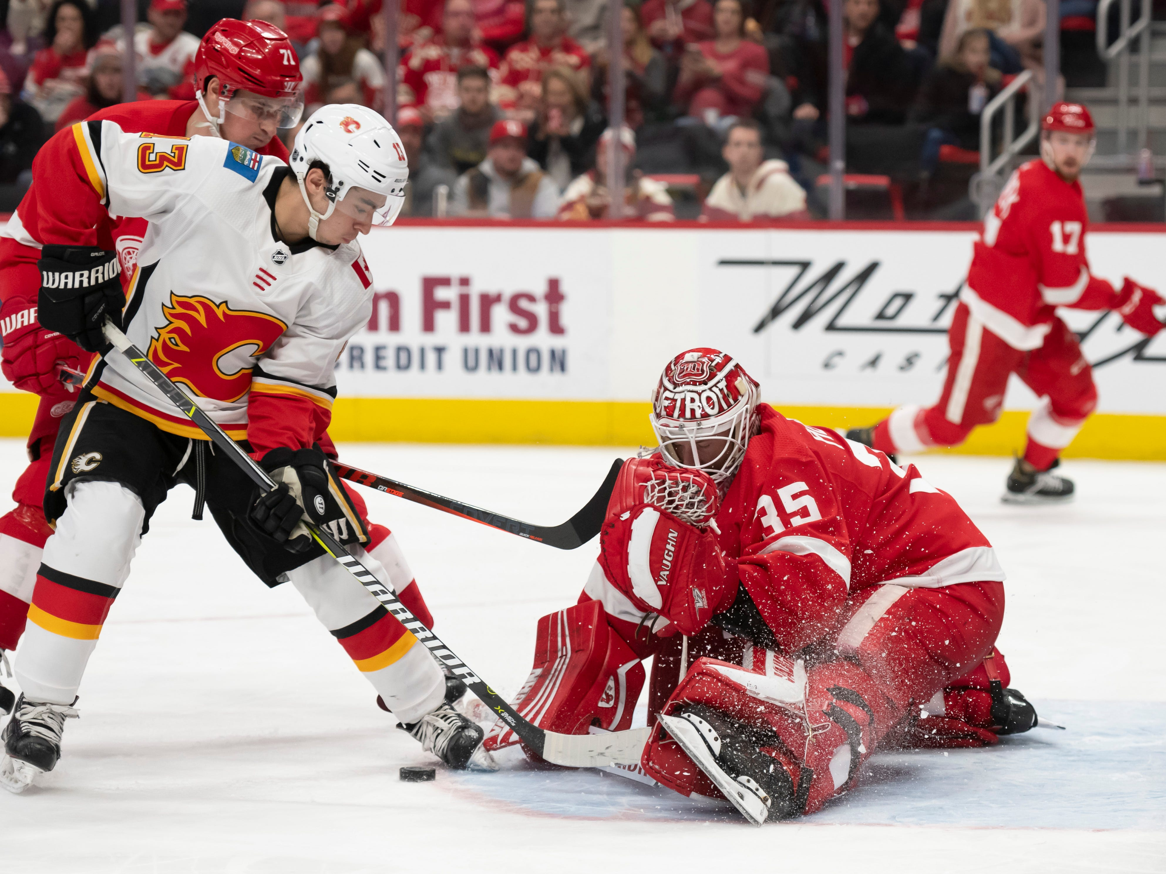 Calgary left wing Johnny Gaudreau tries to shoot the puck past Detroit goaltender Jimmy Howard in the second period.