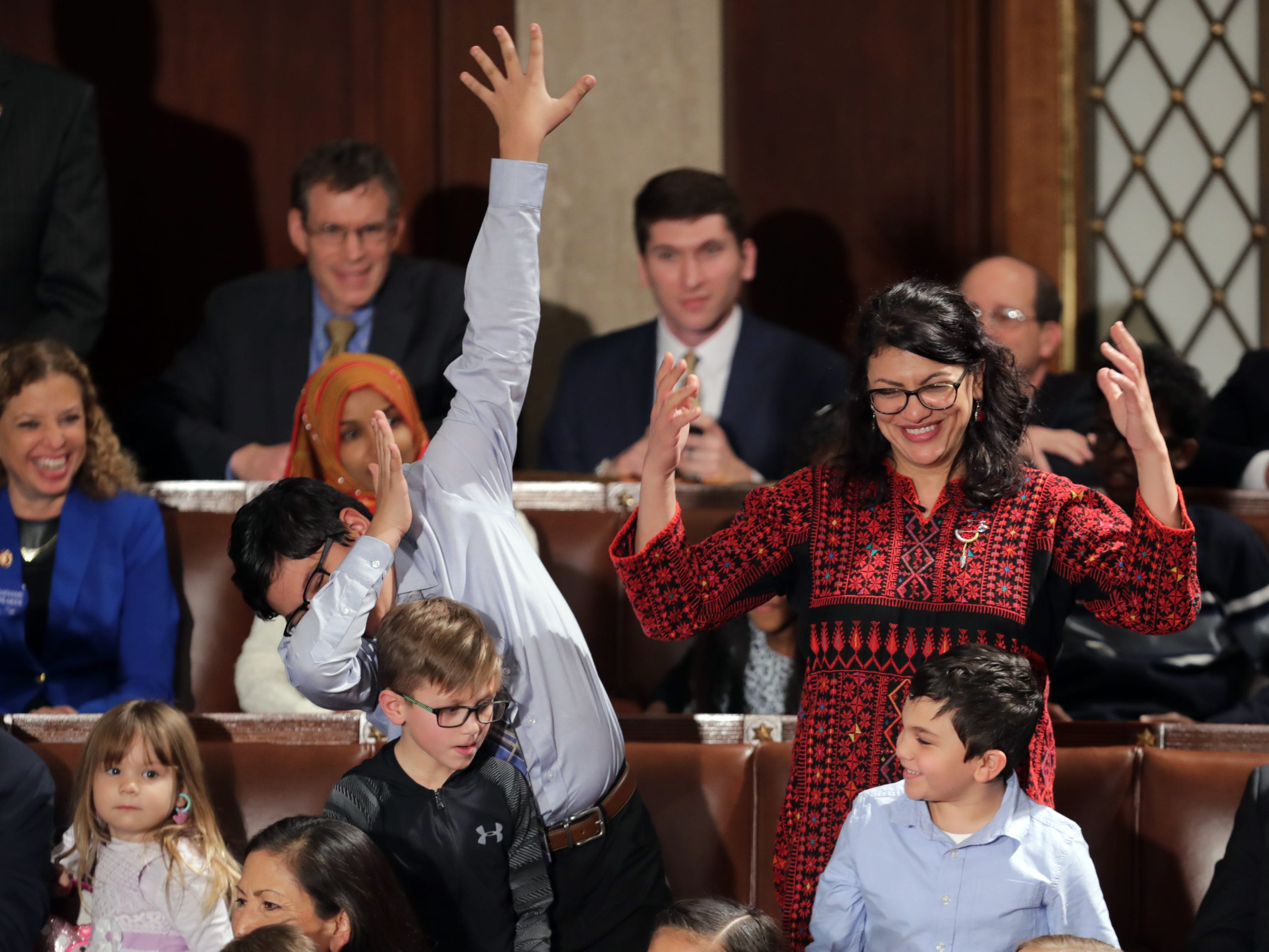 Rep.-elect Rashida Tlaib, D-Michigan, votes for Speaker-designate Rep. Nancy Pelosi, D-California, while her son does a dance move during the first session of the 116th Congress at the U.S. Capitol Jan. 3, 2019, in Washington, D.C. Under the cloud of a partial federal government shutdown, Pelosi will reclaim her former title as speaker of the House and her fellow Democrats will take control of the House of Representatives for the second time in eight years.