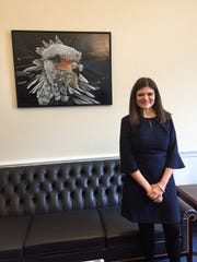 """Rep. Haley Stevens hung a painting, """"Madam Secretary,"""" by her mother, Maria Marcotte, in her new congressional office  in Washington D.C. on Thursday, January 3, 2019."""