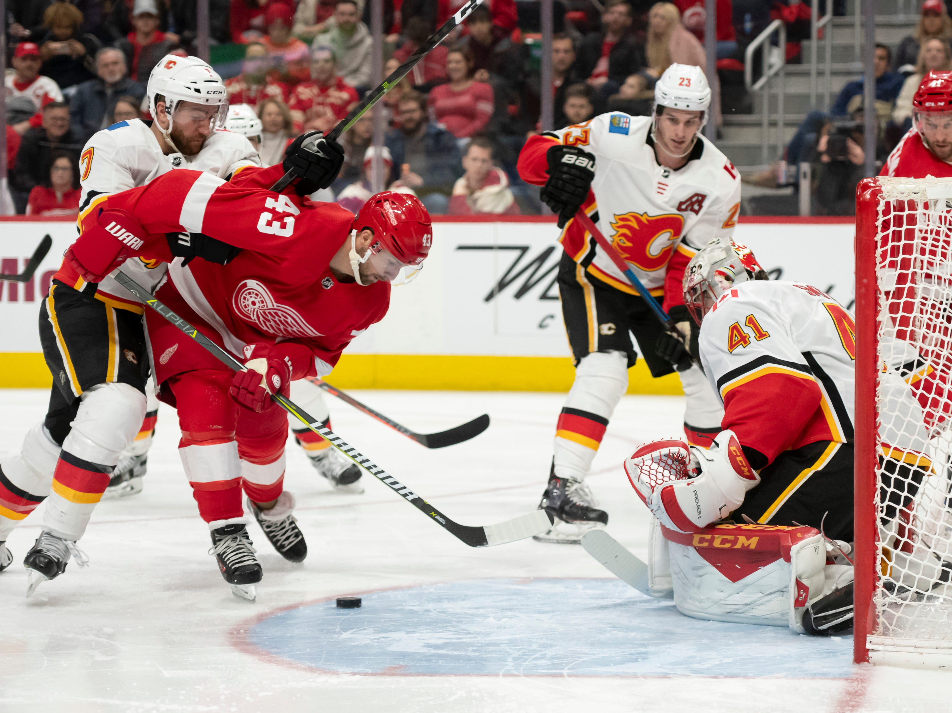 Detroit center Darren Helm tries to get the puck past Calgary goaltender Mike Smith in the third period.