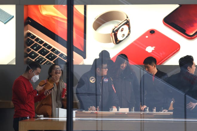Customers visit an Apple store in Beijing, China, Thursday, Jan. 3, 2019.