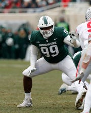 Michigan State defensive tackle Raequan Williams says he'll be back in East Lansing next season for his senior year.