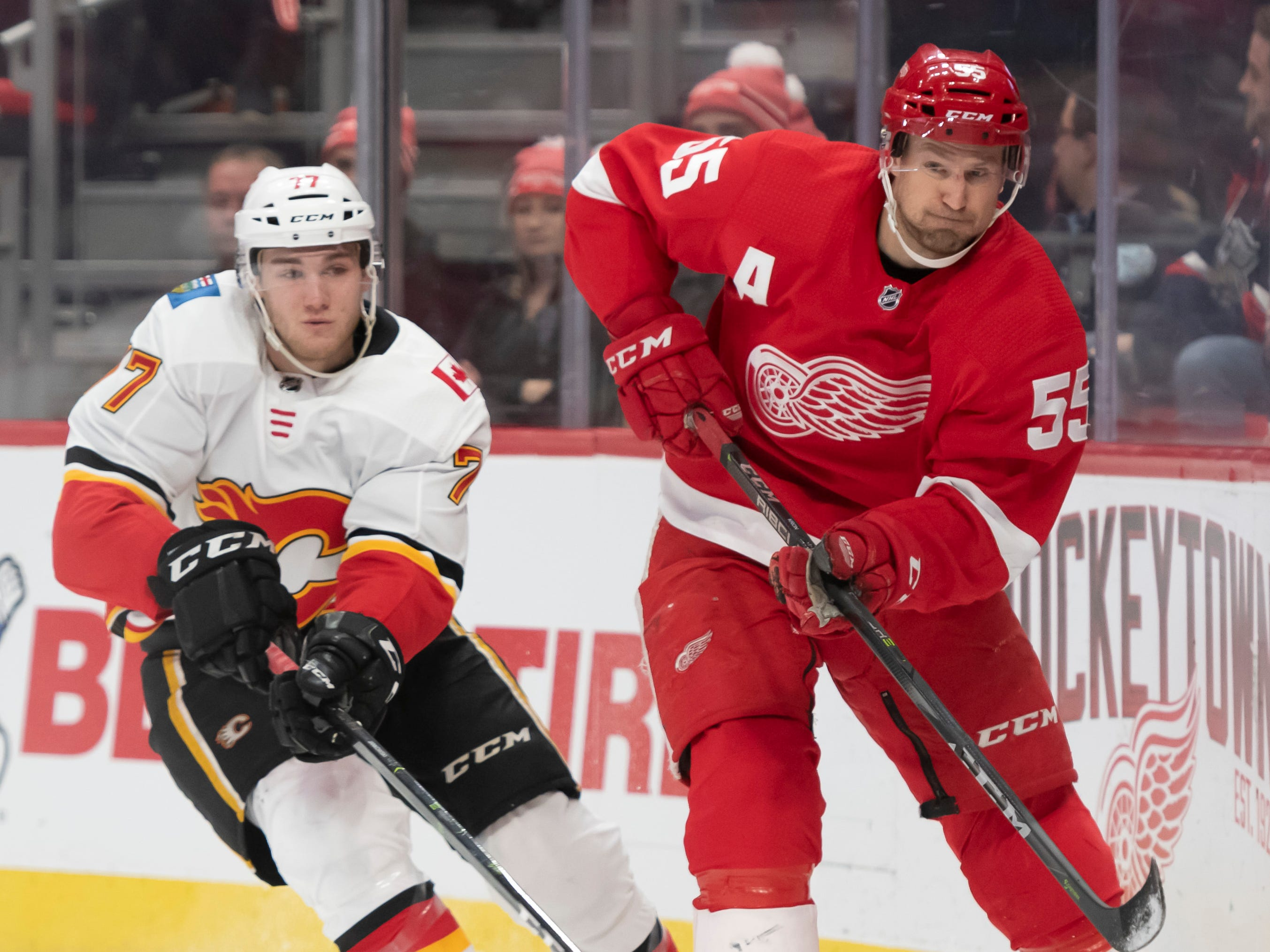 Detroit defenseman Niklas Kronwall passes the puck away from Calgary center Mark Jankowski in the second period.