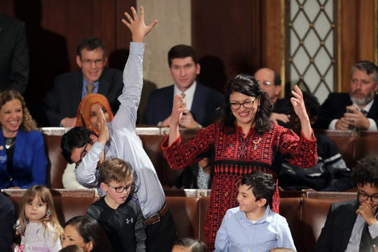 Rep.-elect Rashida Tlaib (D-Detroit) votes for Speaker-designate Rep. Nancy Pelosi (D-CA) while her son does a dance move  during the first session of the 116th Congress, Thursday at the U.S. Capitol.