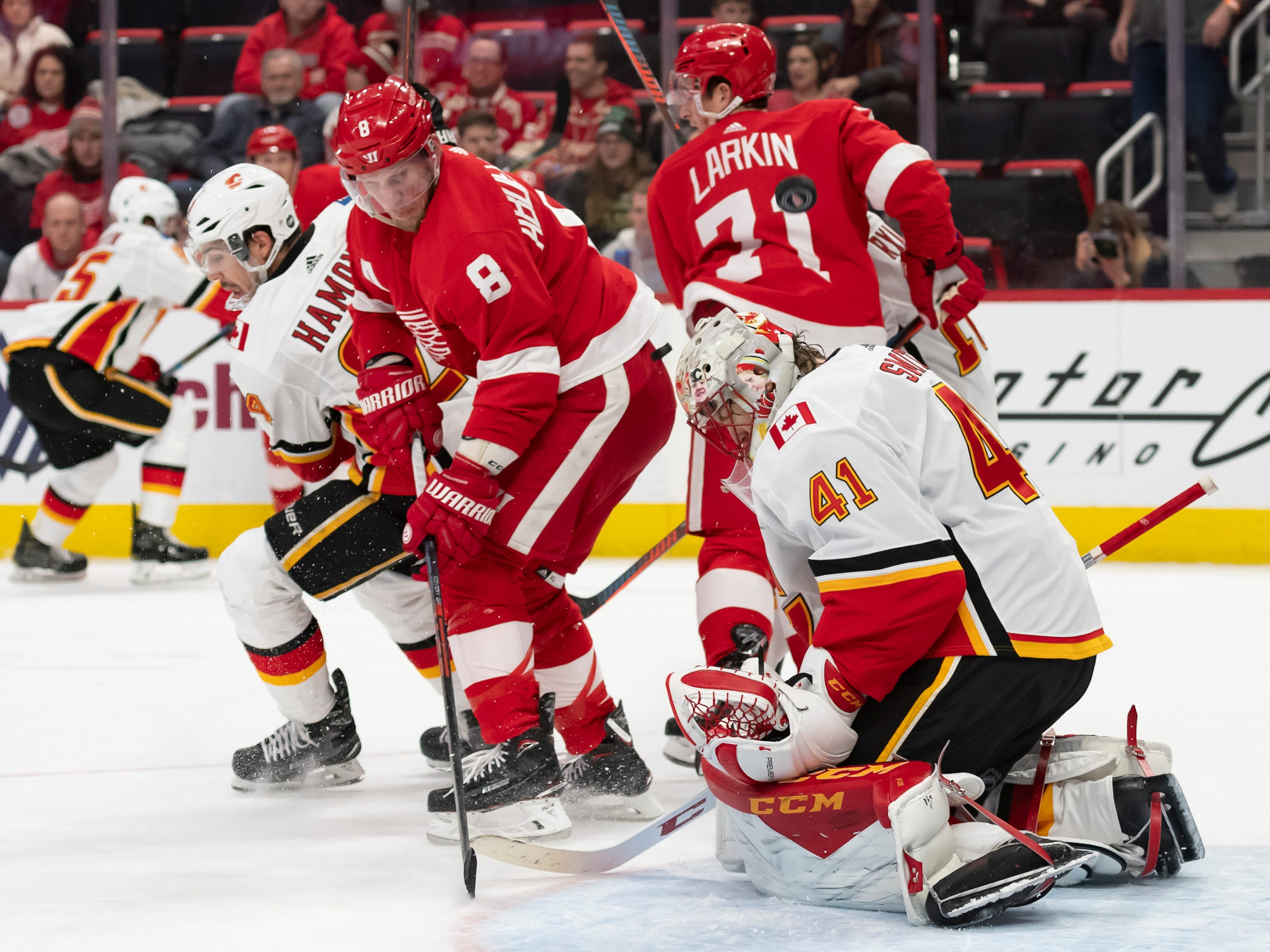 Detroit left wing Justin Abdelkader tries to deflect the puck past Calgary goaltender Mike Smith in the first period.