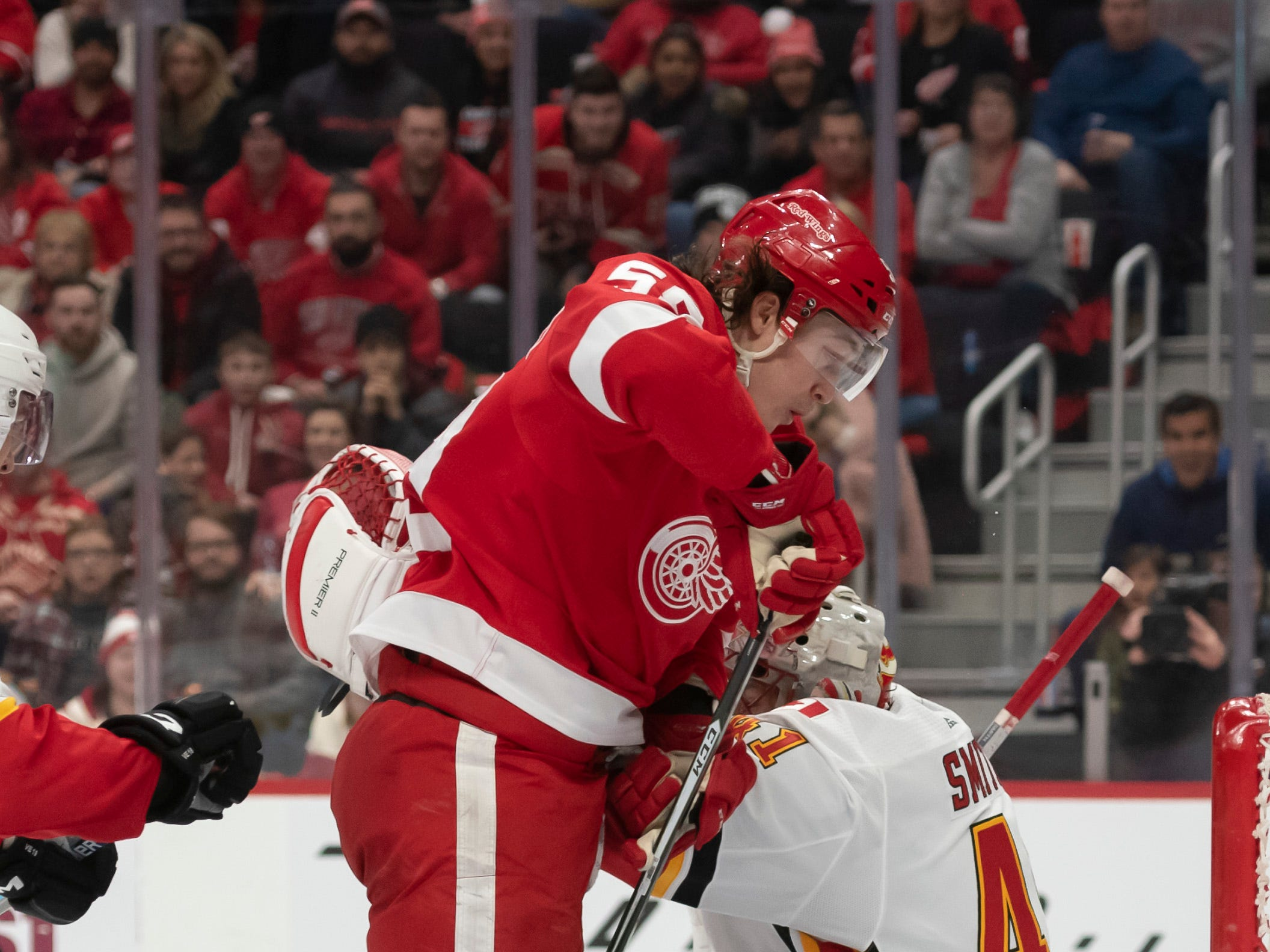 Detroit left wing Tyler Bertuzzi leaps into the air in front of Calgary goaltender Mike Smith in the third period.