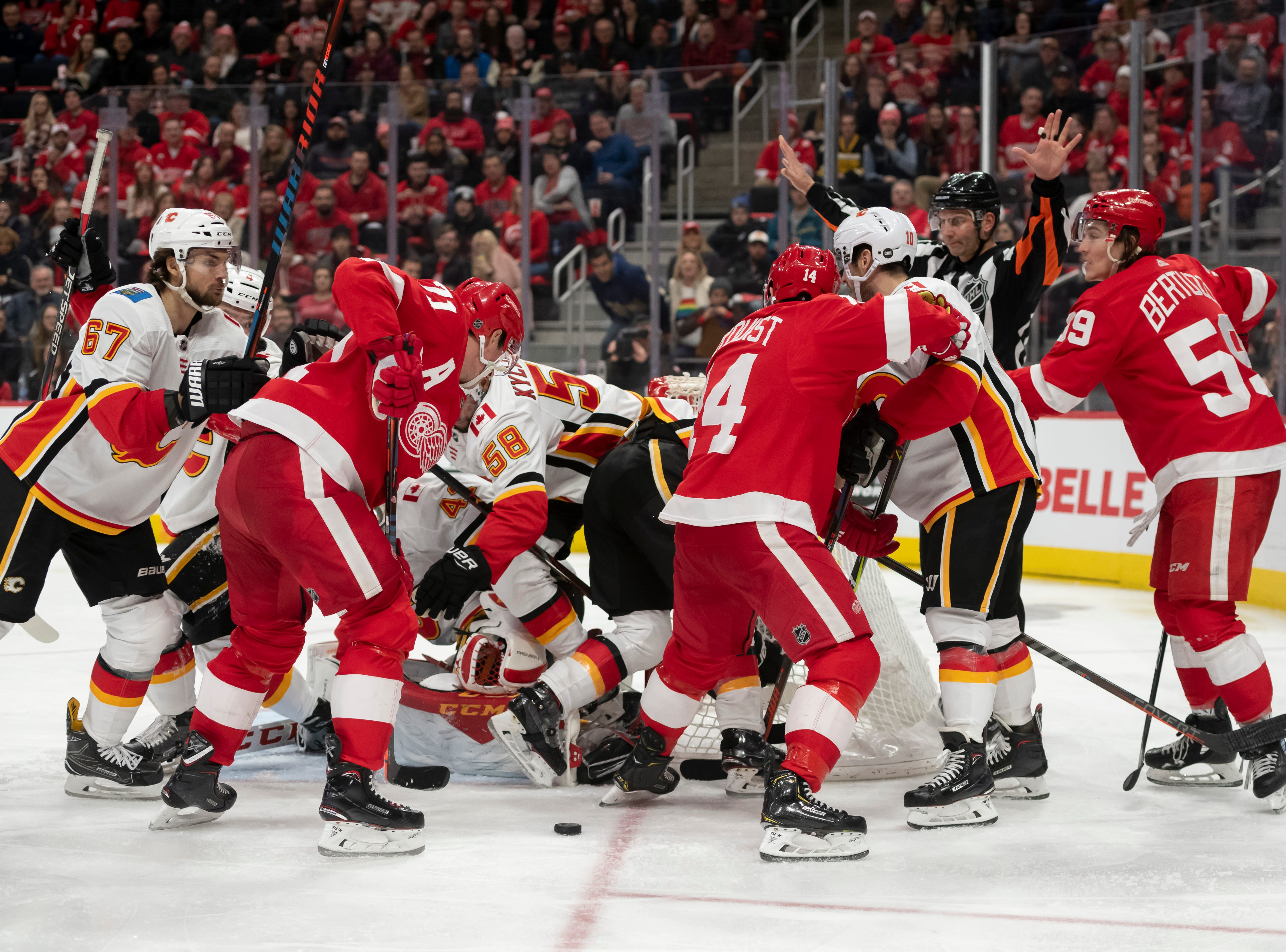 Detroit and Calgary battle for a loose puck in front of Calgary's net in the third period.
