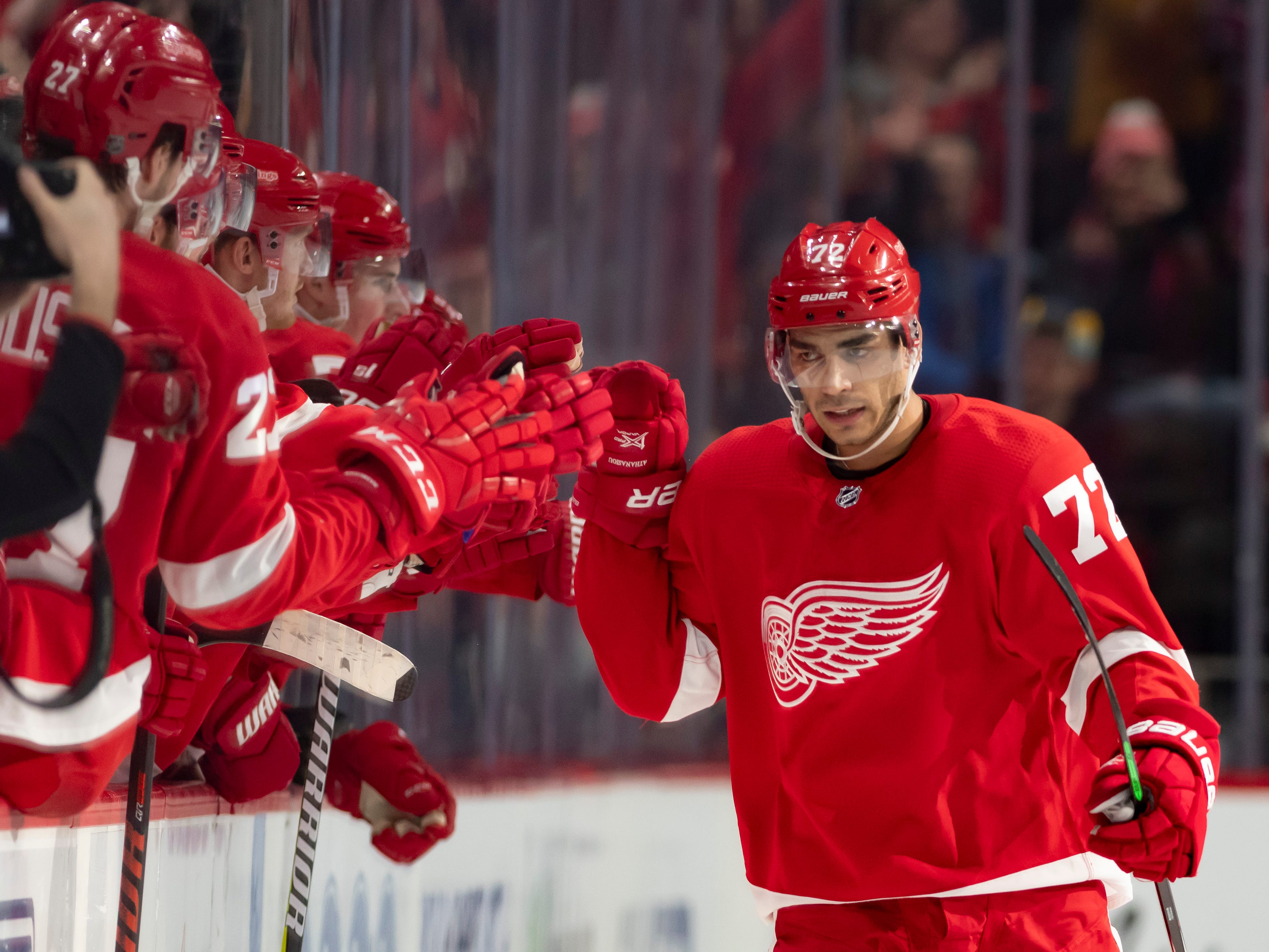 Detroit center Andreas Athanasiou celebrates with his teammates after scoring on a penalty shot in the second period.