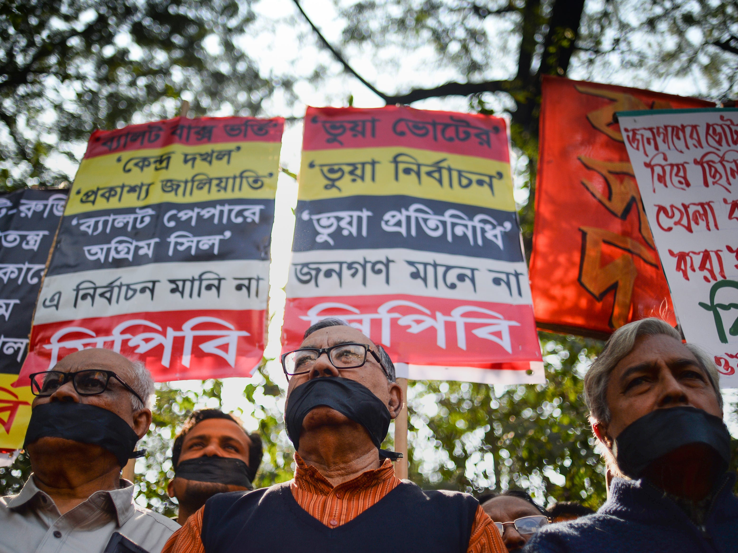 Left-wing activists organised by the Communist Party of Bangladesh wear black cloth over their mouths at a protest against the allegedly fraudulent victory of the ruling Awami League in the recent general election, in Dhaka on Jan. 3, 2019.