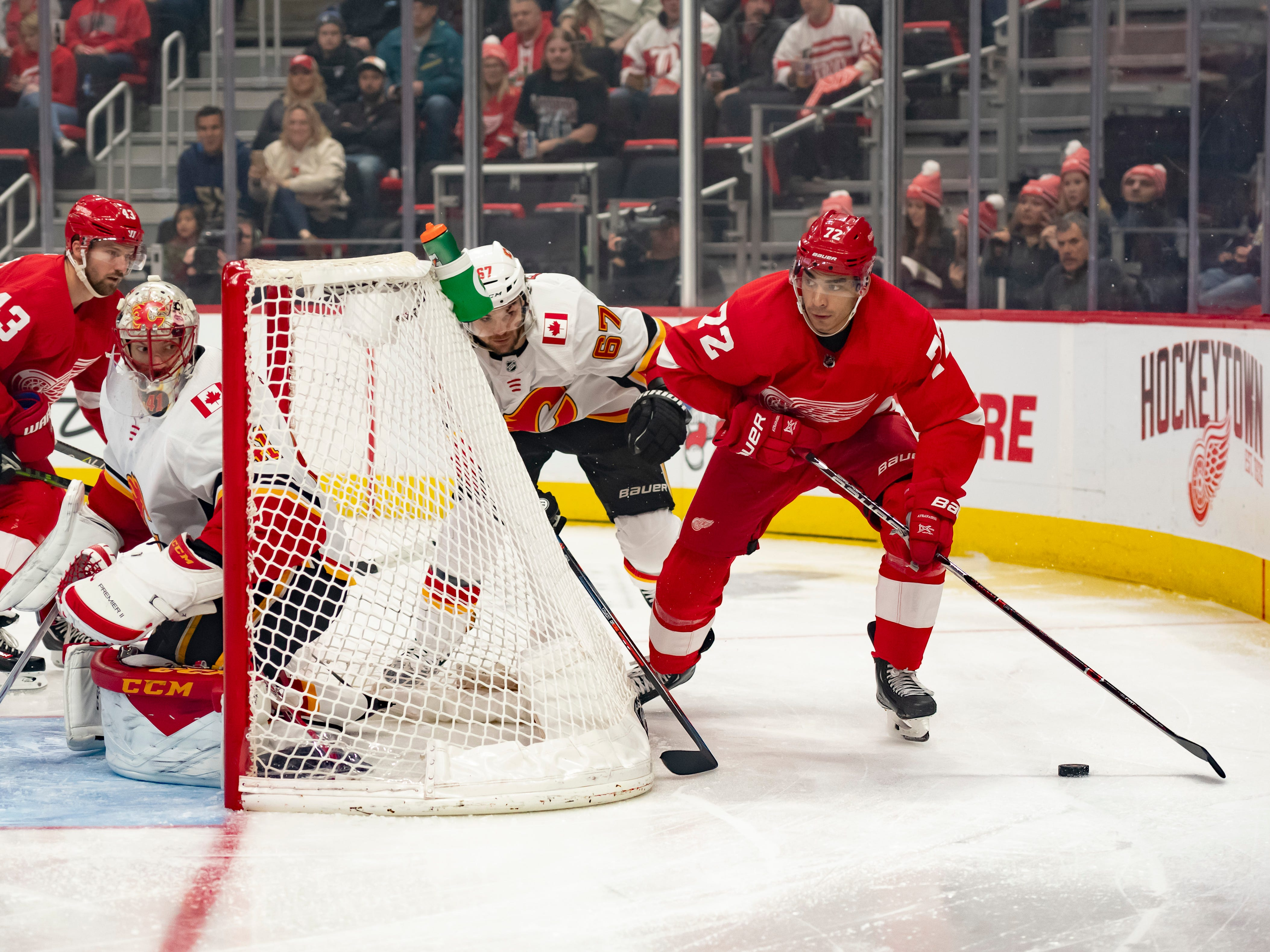 Detroit center Andreas Athanasiou looks for an open man in the first period.