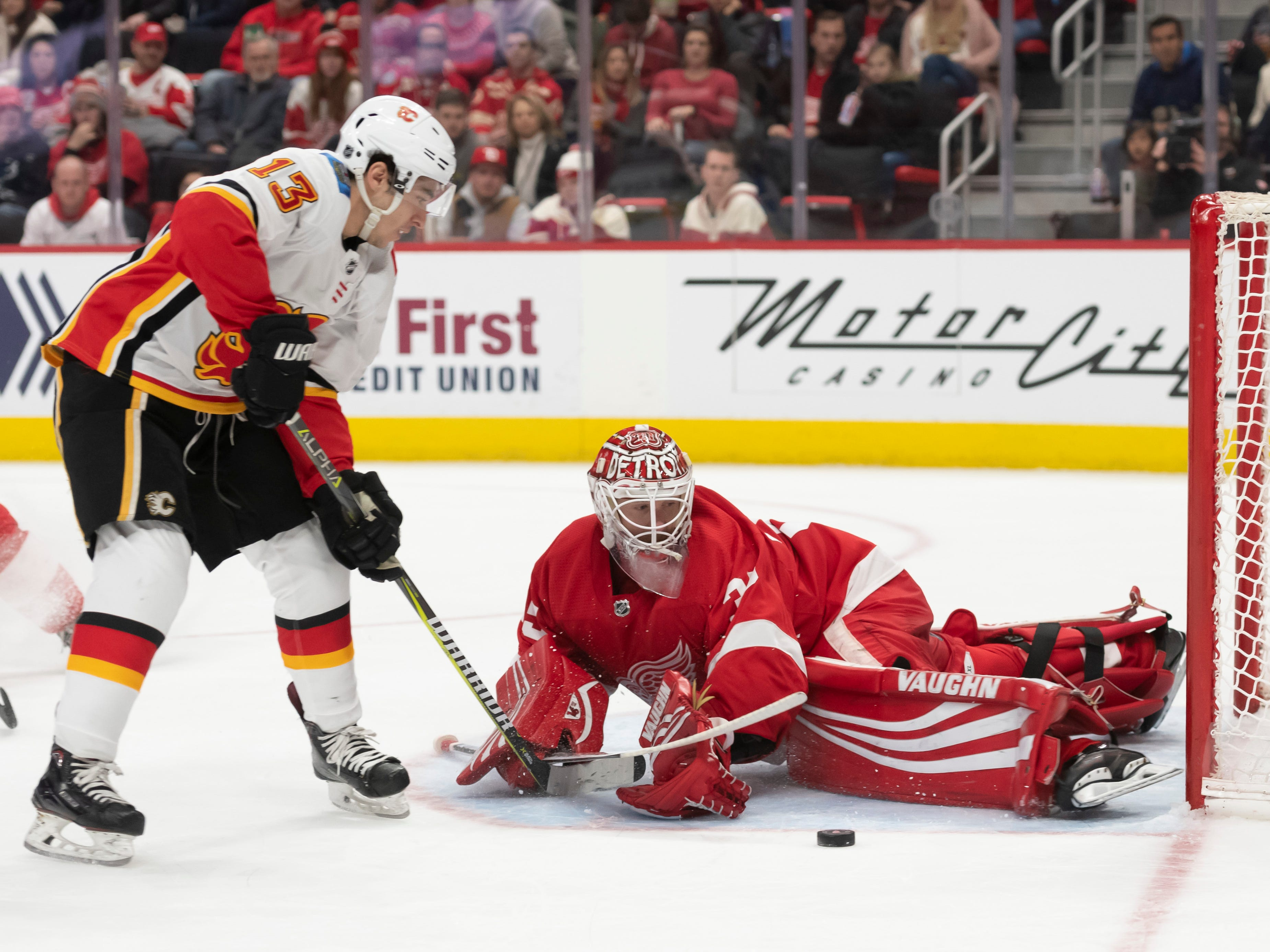 Calgary left wing Johnny Gaudreau gets a breakaway shot stopped by Detroit goaltender Jimmy Howard in the second period.