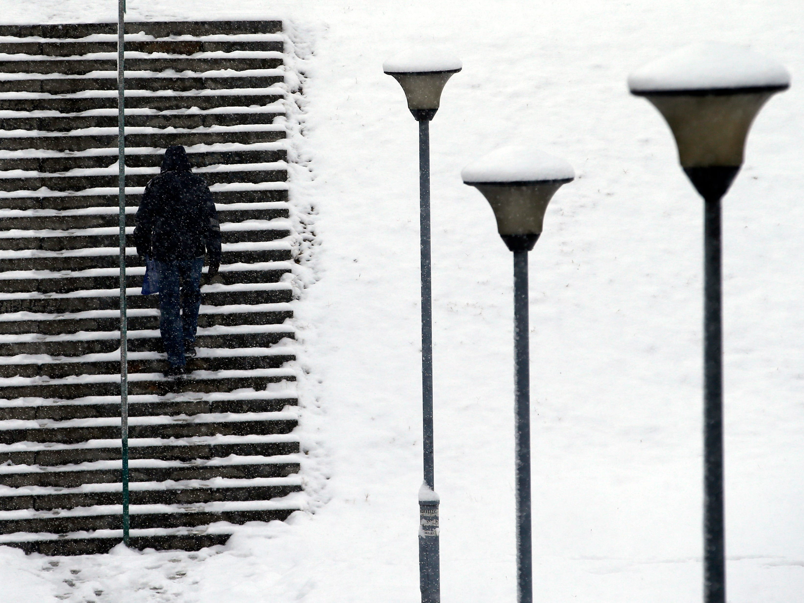 A man walks through a snow-covered park in Belgrade, Serbia, Thursday, Jan. 3, 2019. Meteorologists predict heavy snowfall and sub zero temperatures in the Western Balkans throughout the week.