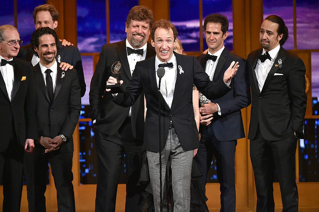 "Producer Jeffrey Seller, center, accepts the Tony award for Best Musical for ""Hamilton"" onstage with his cast and creative team during the 70th Annual Tony Awards on June 12, 2016 in New York City."