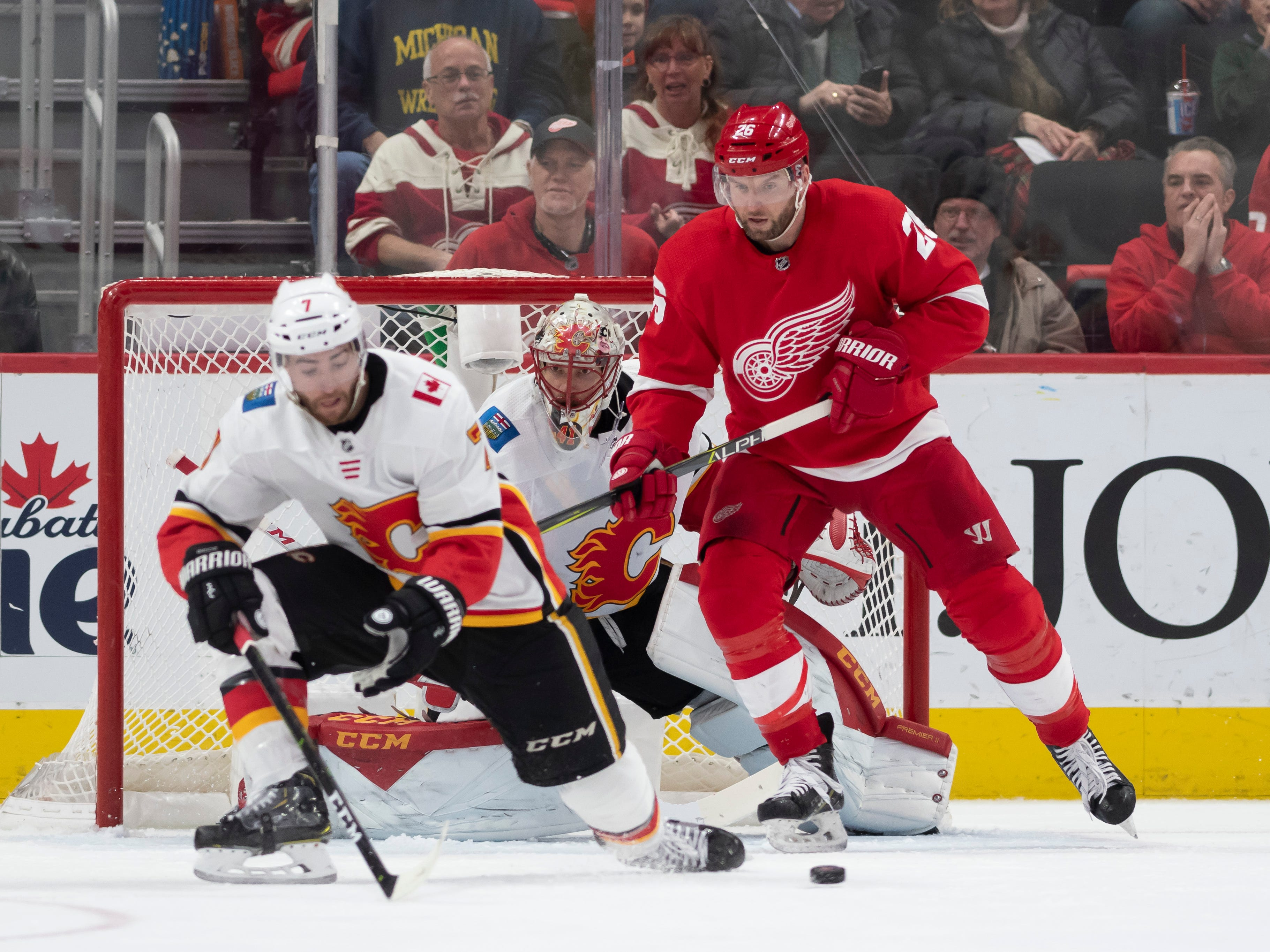 Detroit left wing Thomas Vanek tries to get the puck past Calgary defenseman T.J. Brodie and goaltender Mike Smith in the second period.