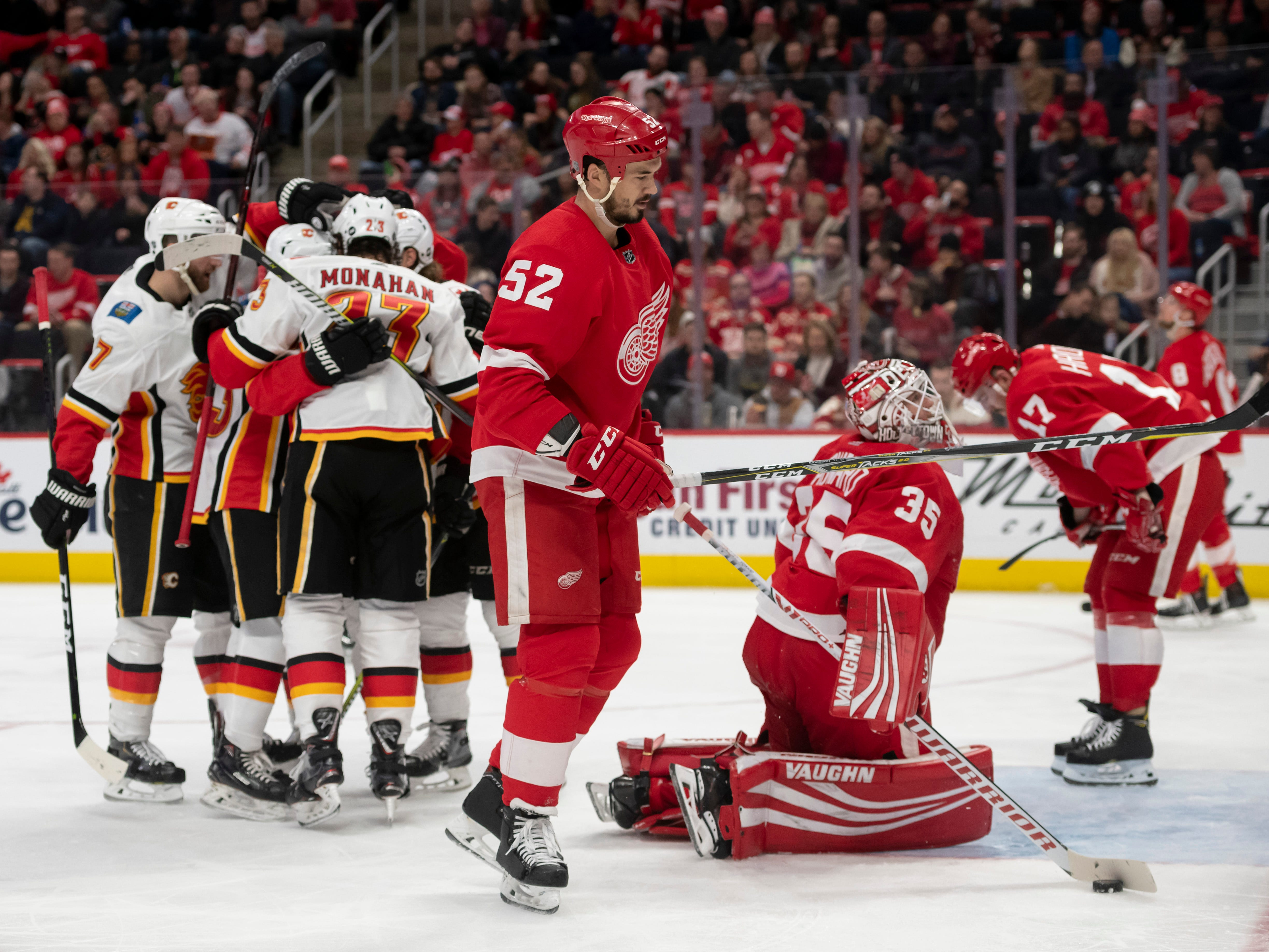 The Red Wings look away as Calgary celebrates a goal by center Sean Monahan in the second period.