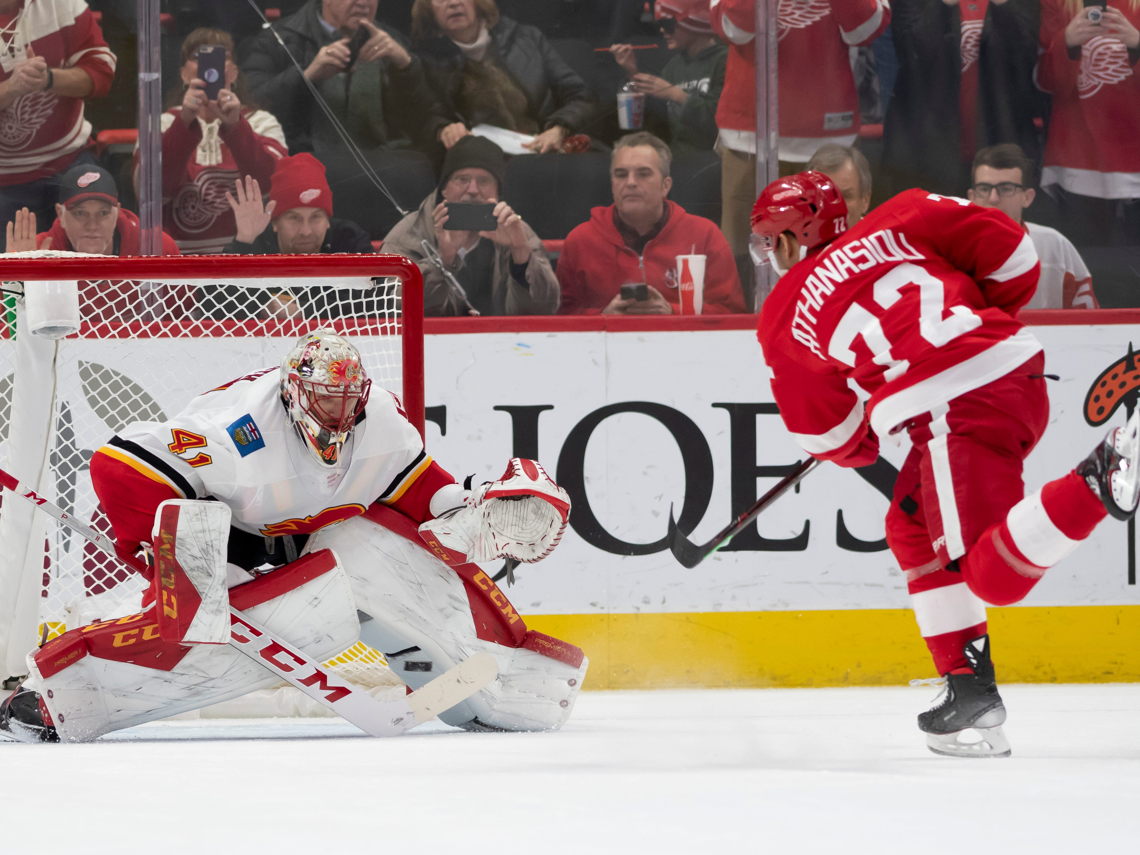 Detroit center Andreas Athanasiou sends a shot past Calgary goaltender Mike Smith for a goal during a penalty shot in the second period.