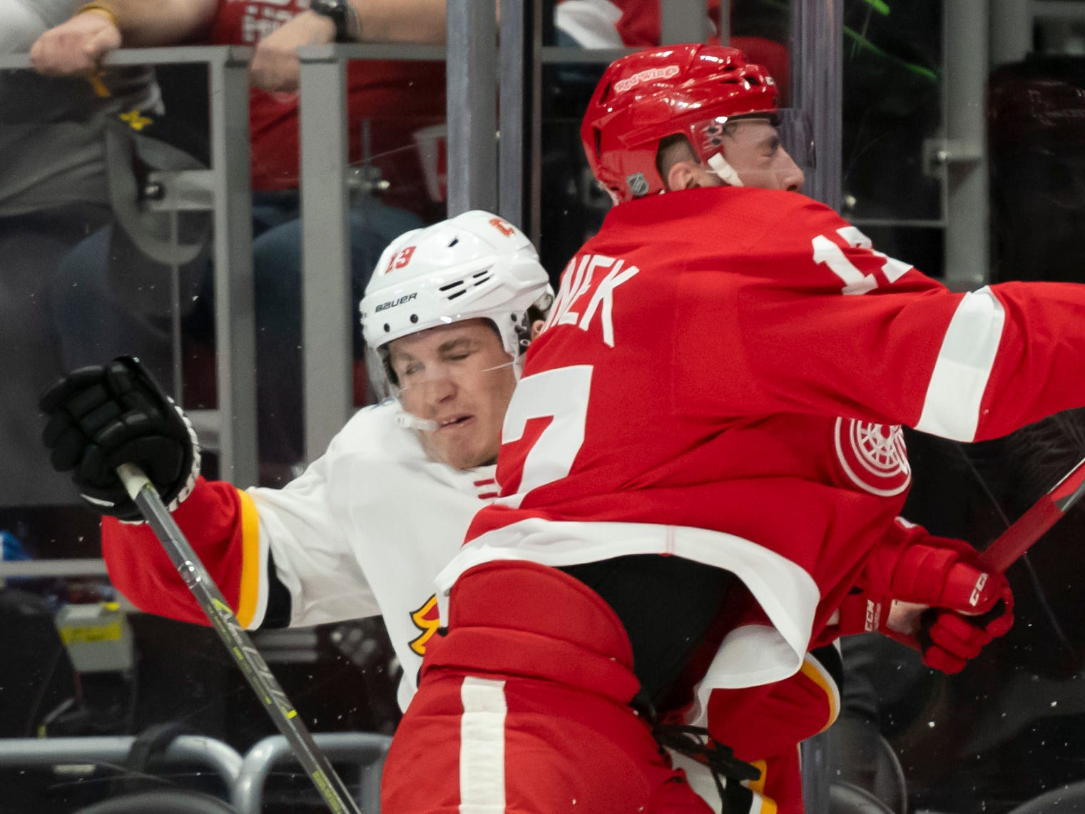 Detroit defenseman Filip Hronek checks Calgary left wing Matthew Tkachuk in the second period.   Hronek was given a charging penalty on the play.