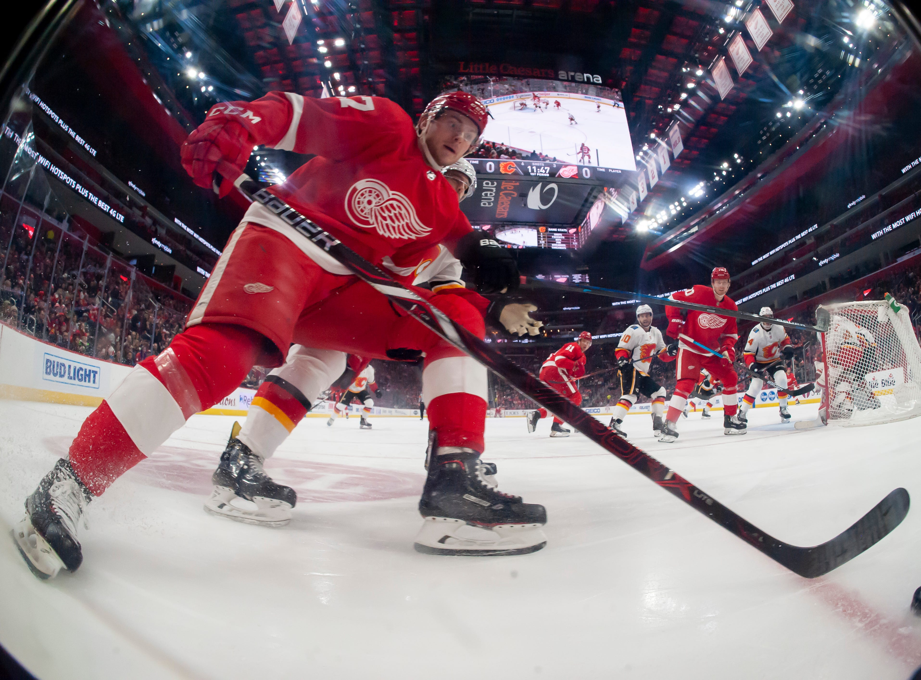 Detroit center Michael Rasmussen races the puck behind Calgary's net in the first period.