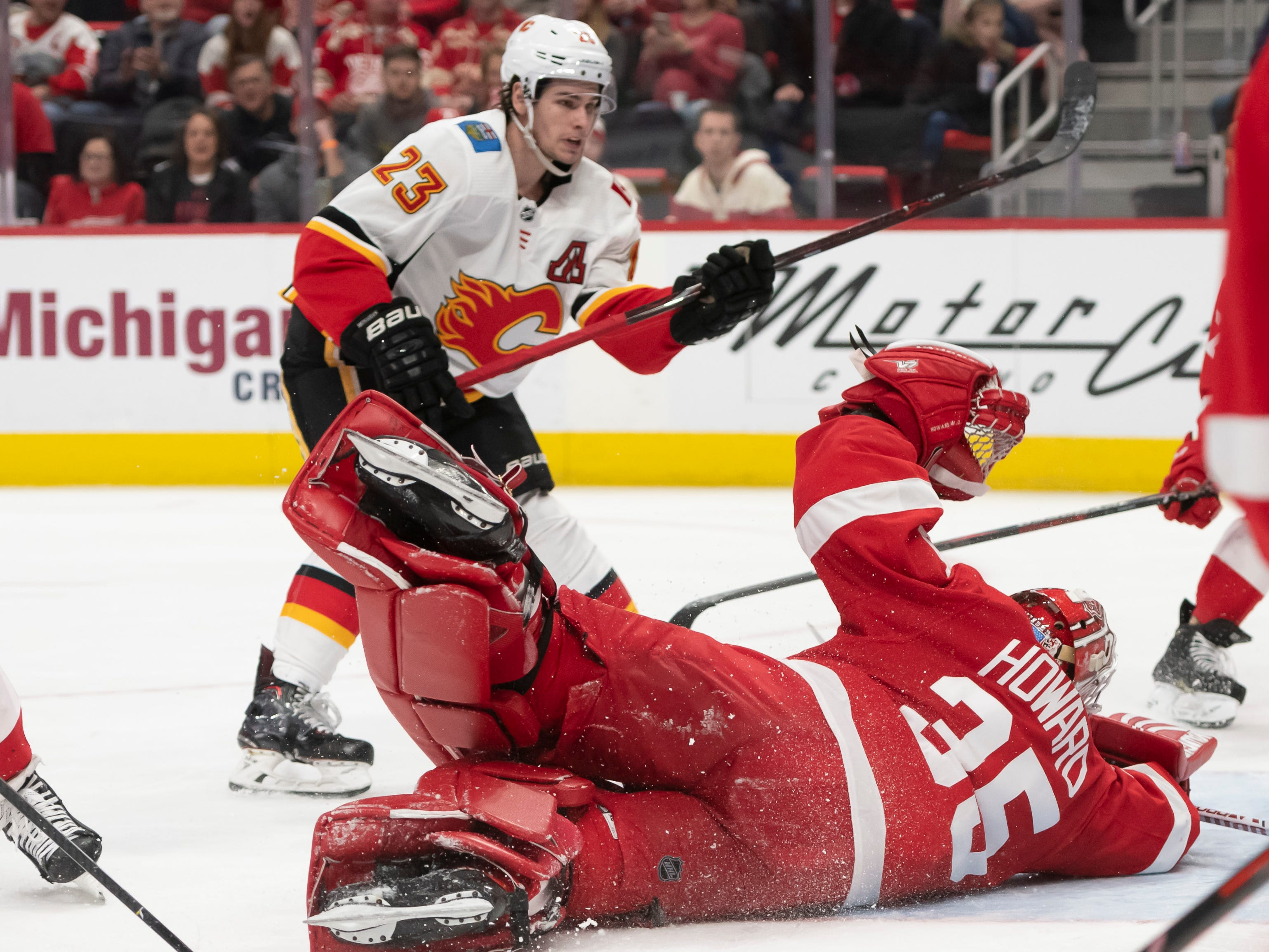 Calgary center Sean Monahan sends the puck past Detroit goaltender Jimmy Howard for a goal in the second period.