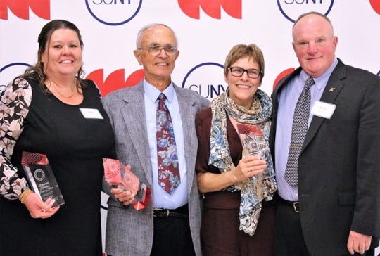 SUNY CCC Athletics Hall of Fame recently recognized several former athletes and coaches. From left are Stacy Johnson, John Polo, and Kelly Keefer, and presenter Ernie Danforth.
