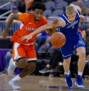 Evansville's Shamar Givance (5) and Drake's Garrett Sturtz (3) battle for the ball at the Ford Center Wednesday night. The Purple Aces beat the Bulldogs 82-77 in double overtime.