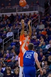 Evansville's Marty Hill (1) shoots for three points over Drake's Brady Ellingson (22) at the Ford Center Wednesday night. The Purple Aces beat the Bulldogs 82-77 in double overtime.